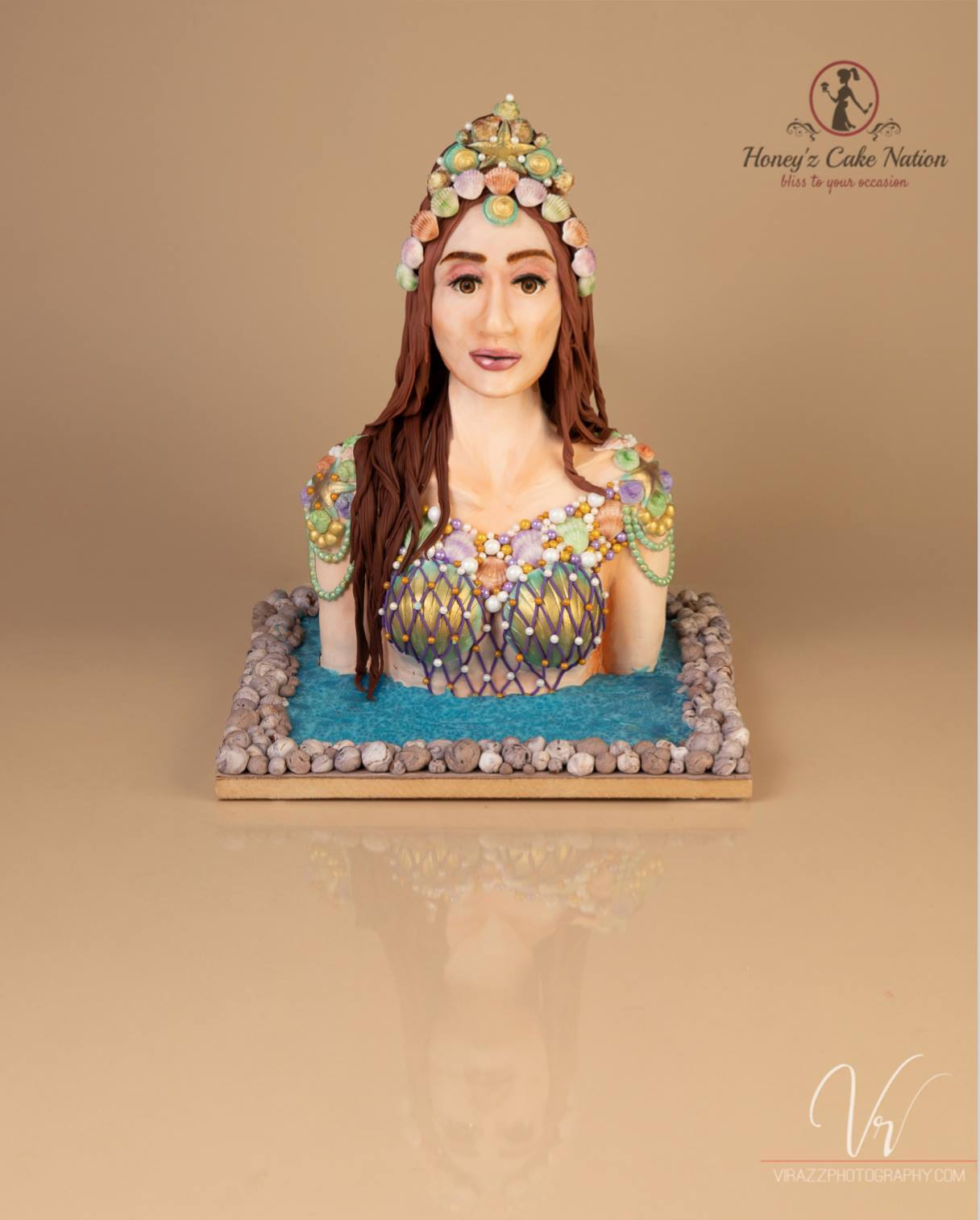 Modeling chocolate mermaid bust cake