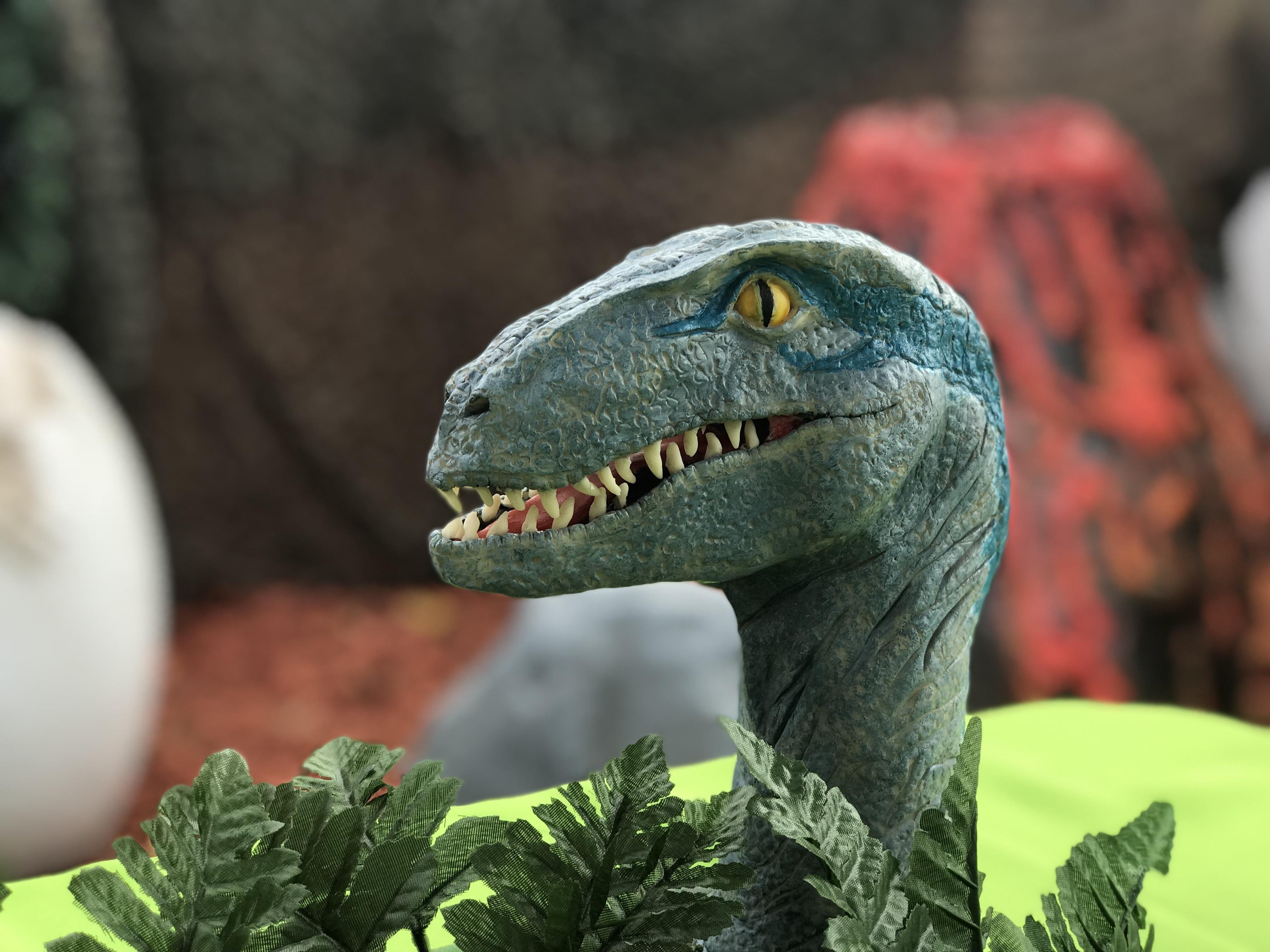 Modeling chocolate t-rex sculpture