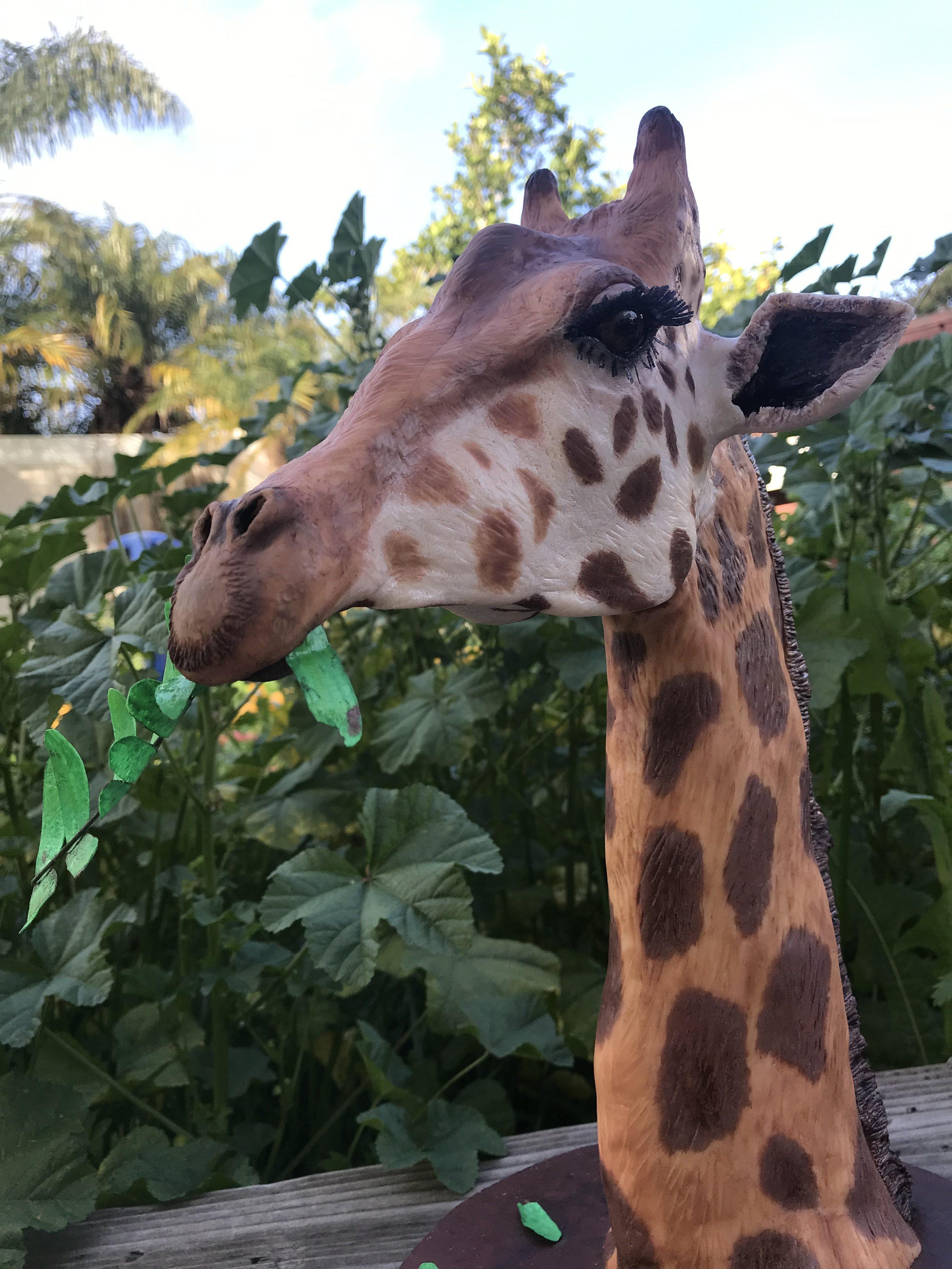 Modeling chocolate giraffe sculpture