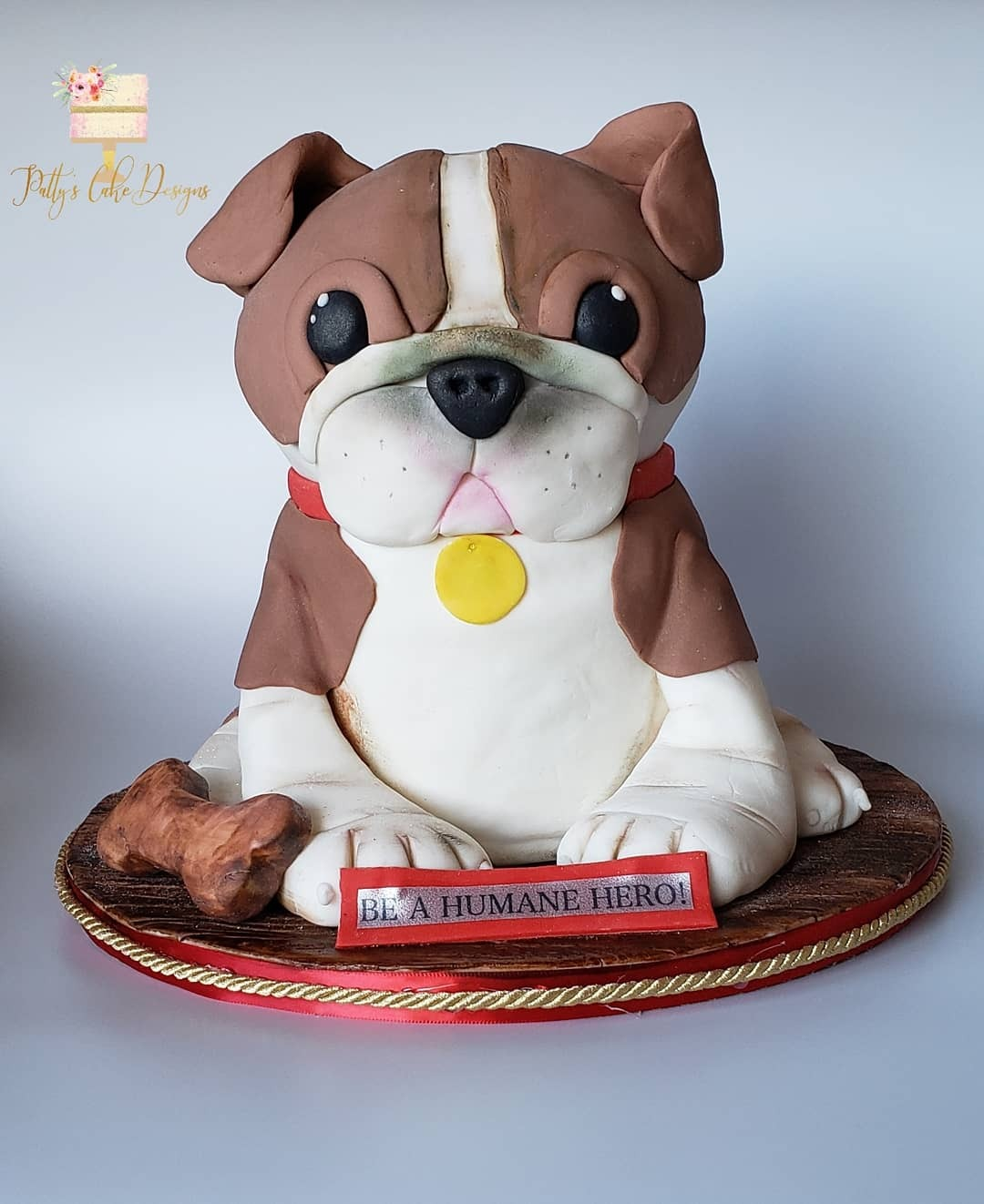 Modeling chocolate puppy bust cake