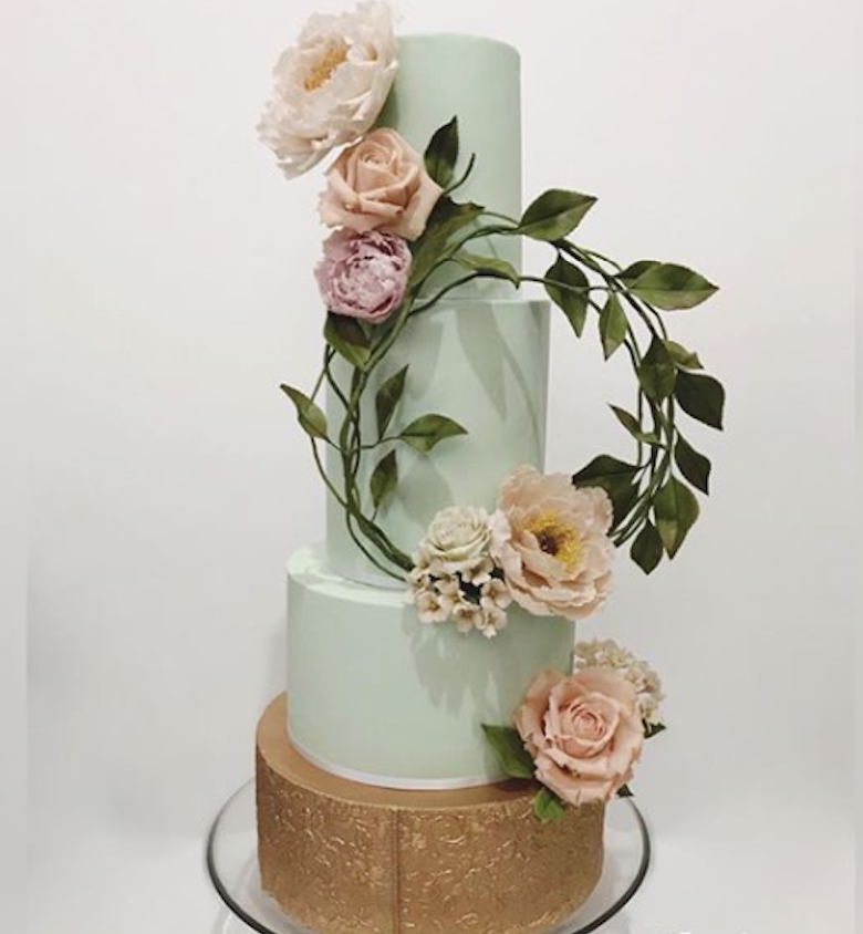Pastel green fondant wedding cake with gold tier
