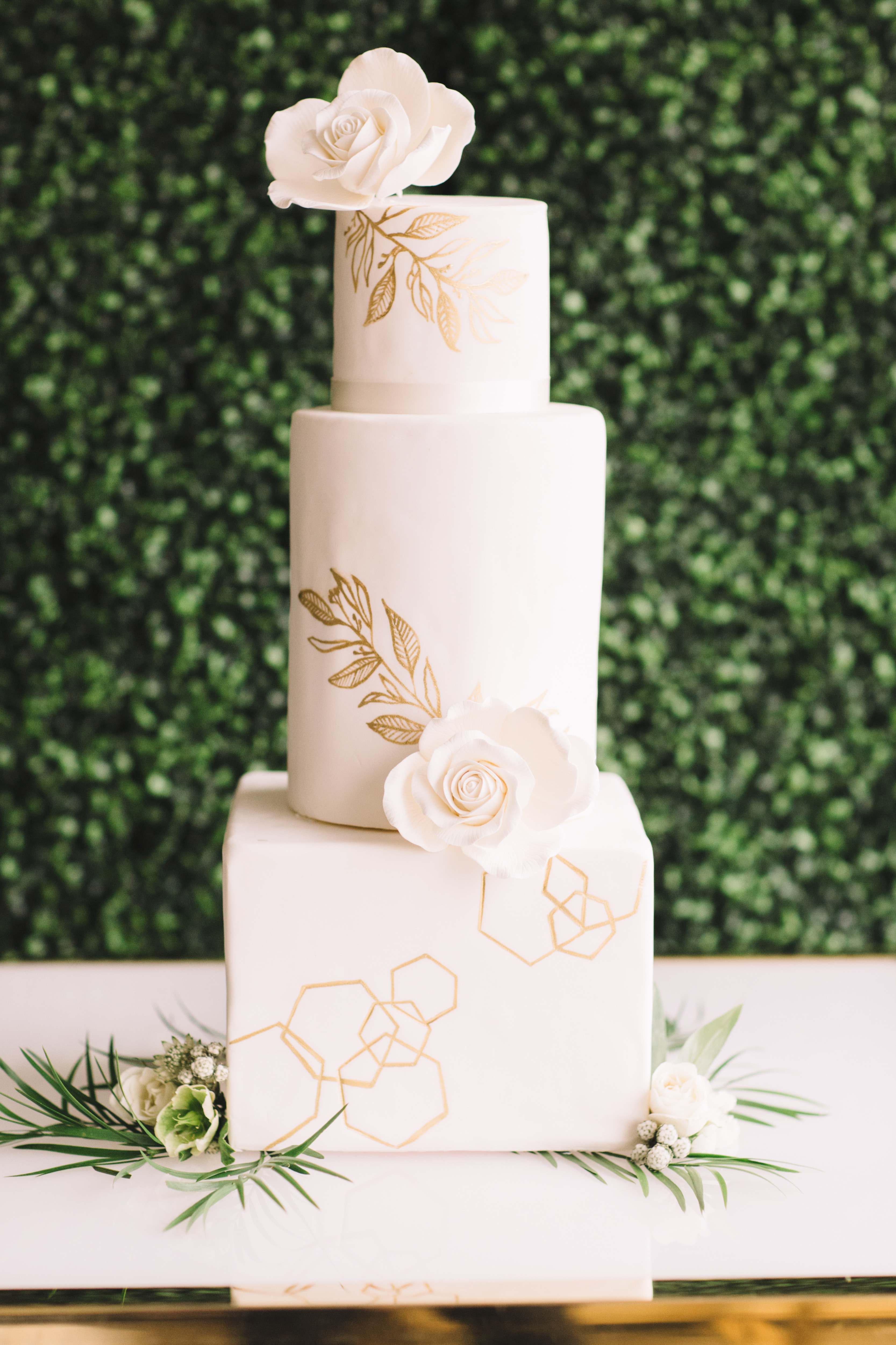 Ivory fondant wedding cake with hand painted gold leaves