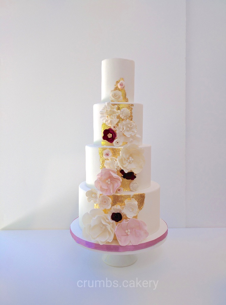 White wedding with gold and pink sugar flowers