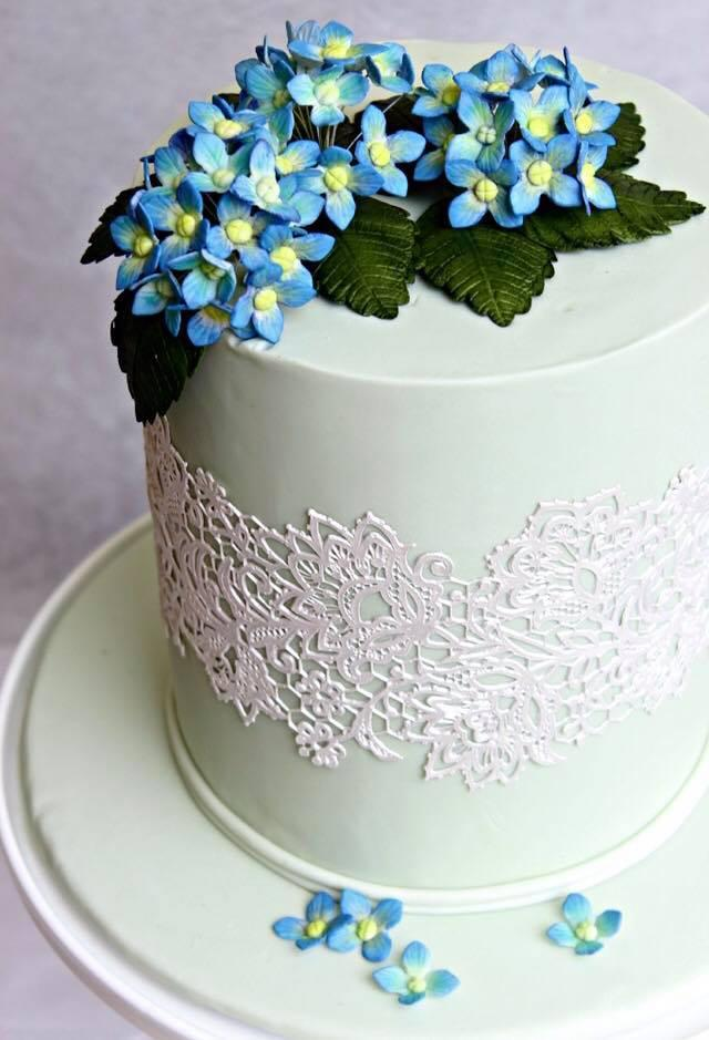 Pastel green fondant cake with sugar flowers