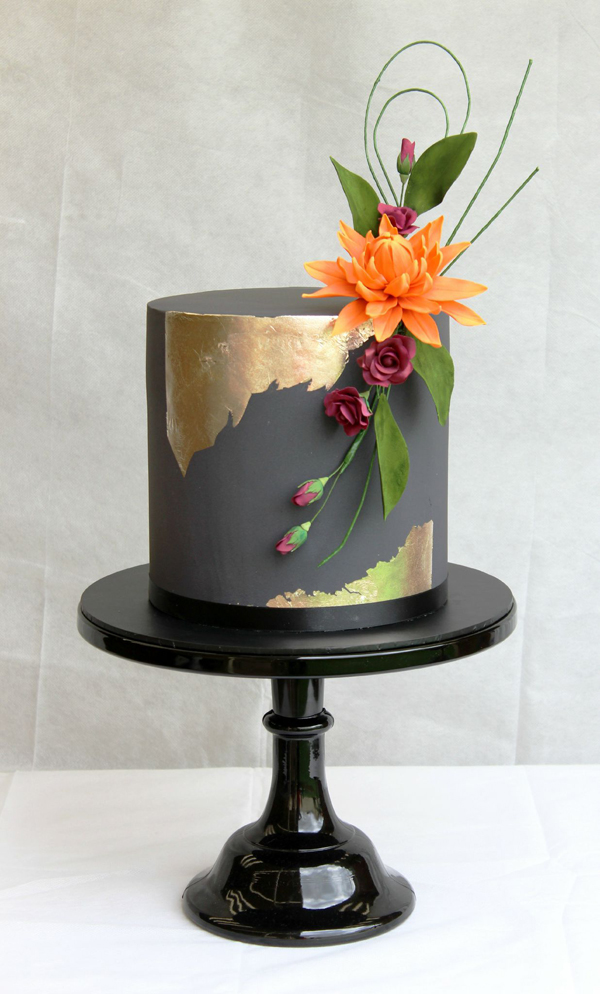 Black fondant cake with gold shimmer