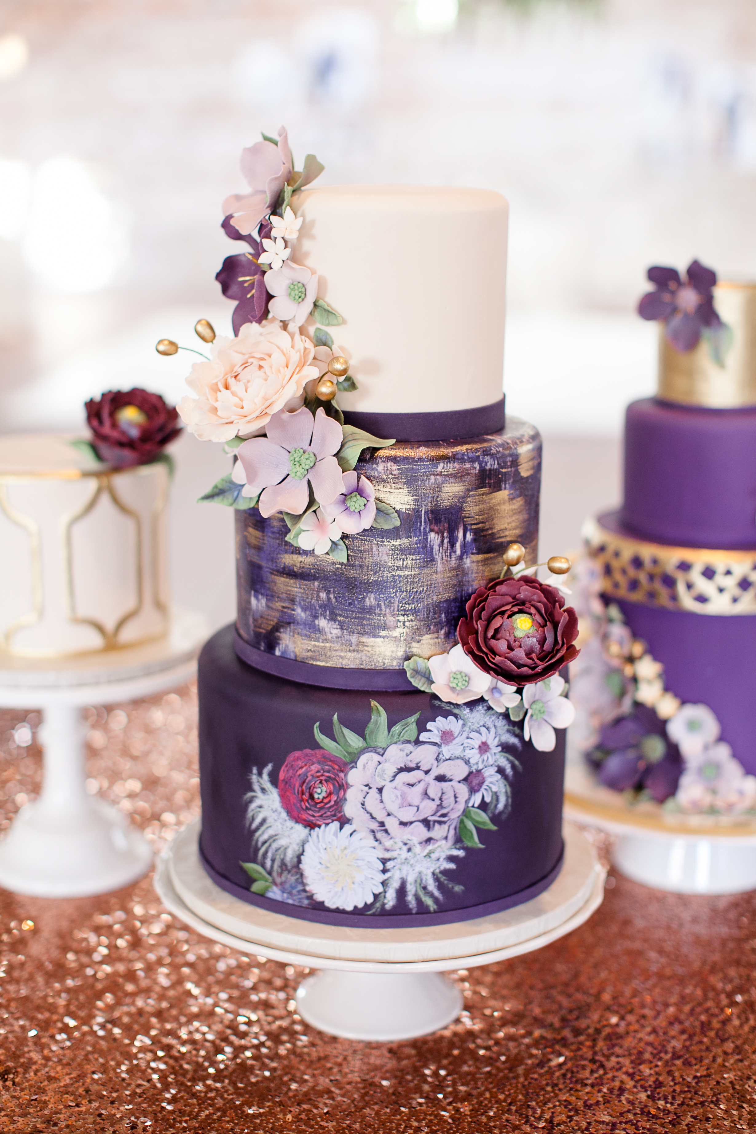 Purple and white hand painted wedding cake