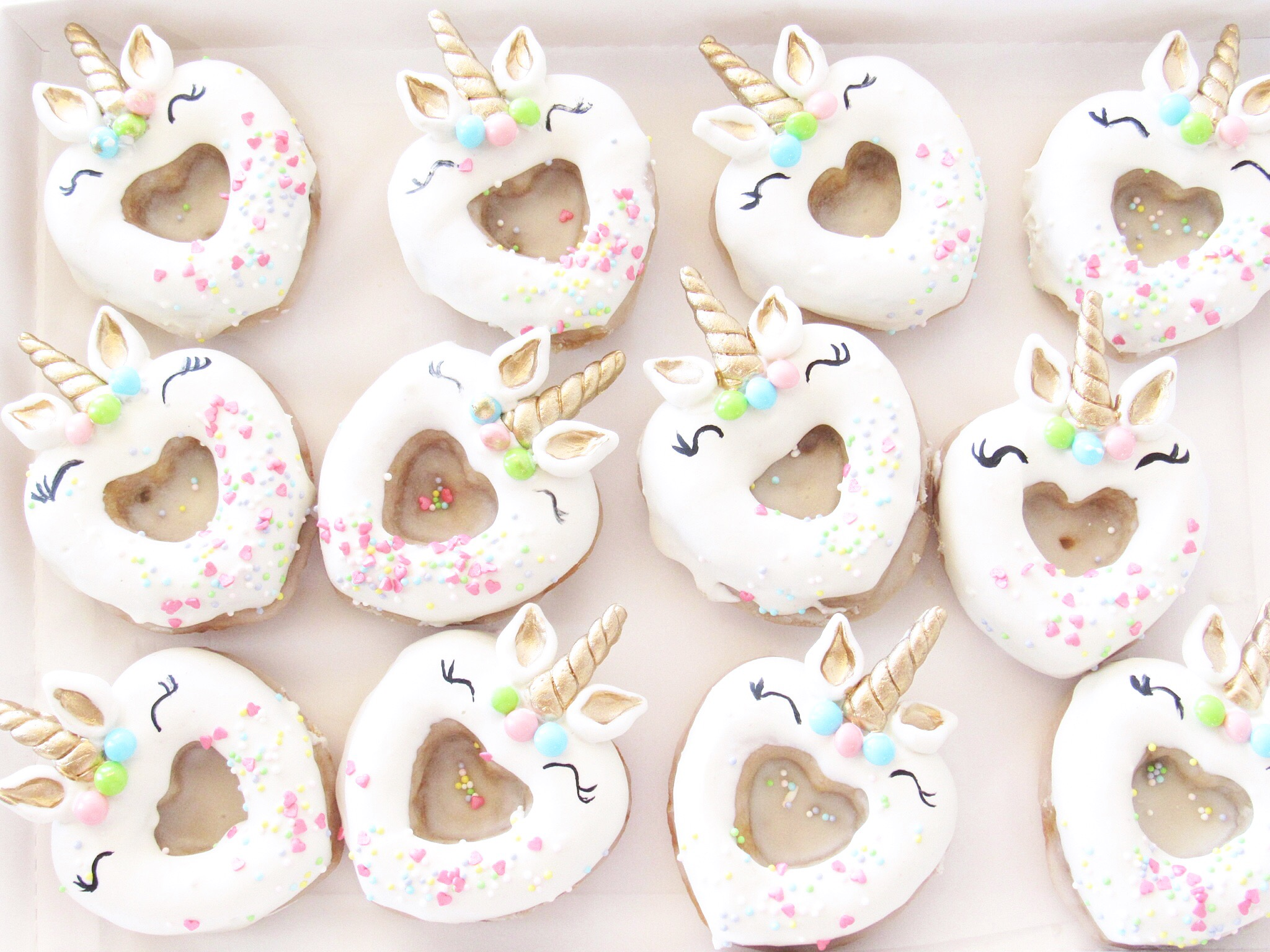 Pink fondant unicorn donuts