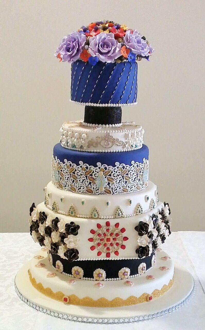 White and Blue opulence Indian themed wedding cake