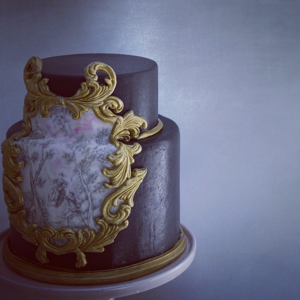 Black wedding cake with gold trim