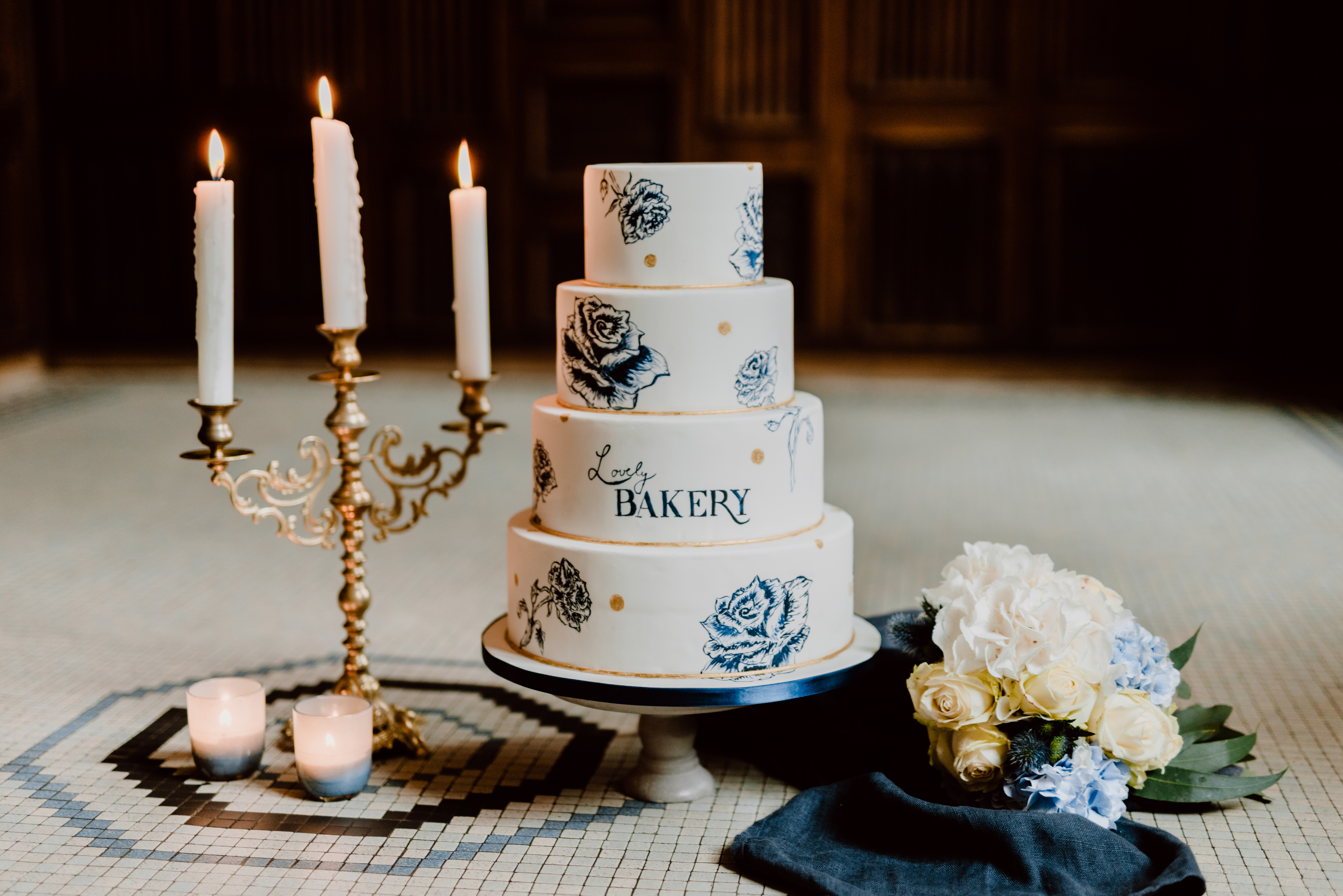 White wedding cake with blue hand painted flowers