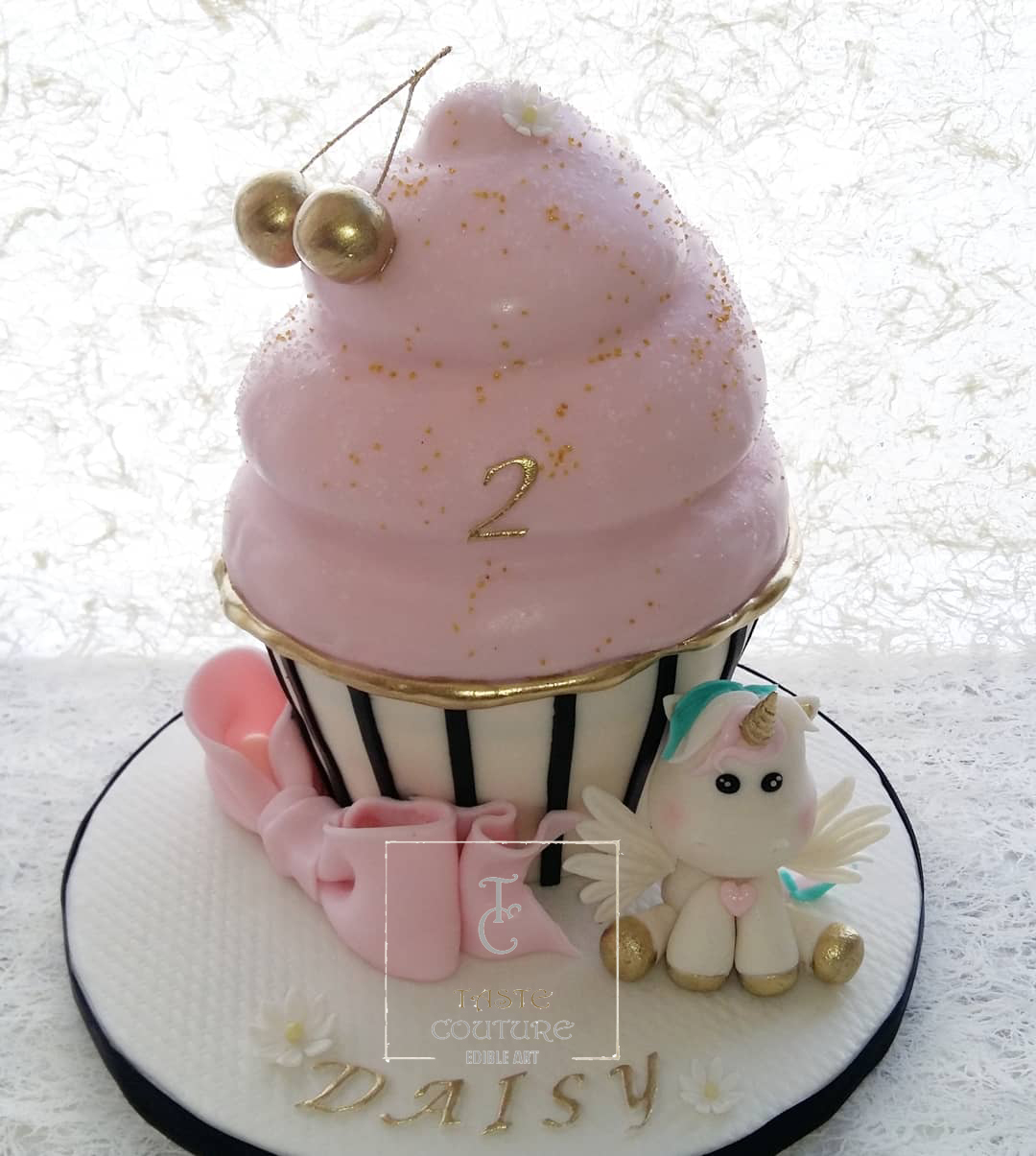Light pink fondant large cupcake shaped cake