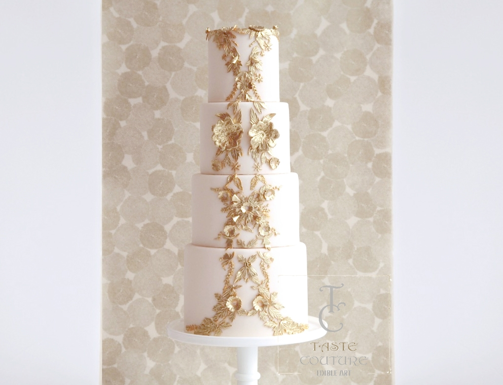 Ivory fondant wedding cake with gold detailing