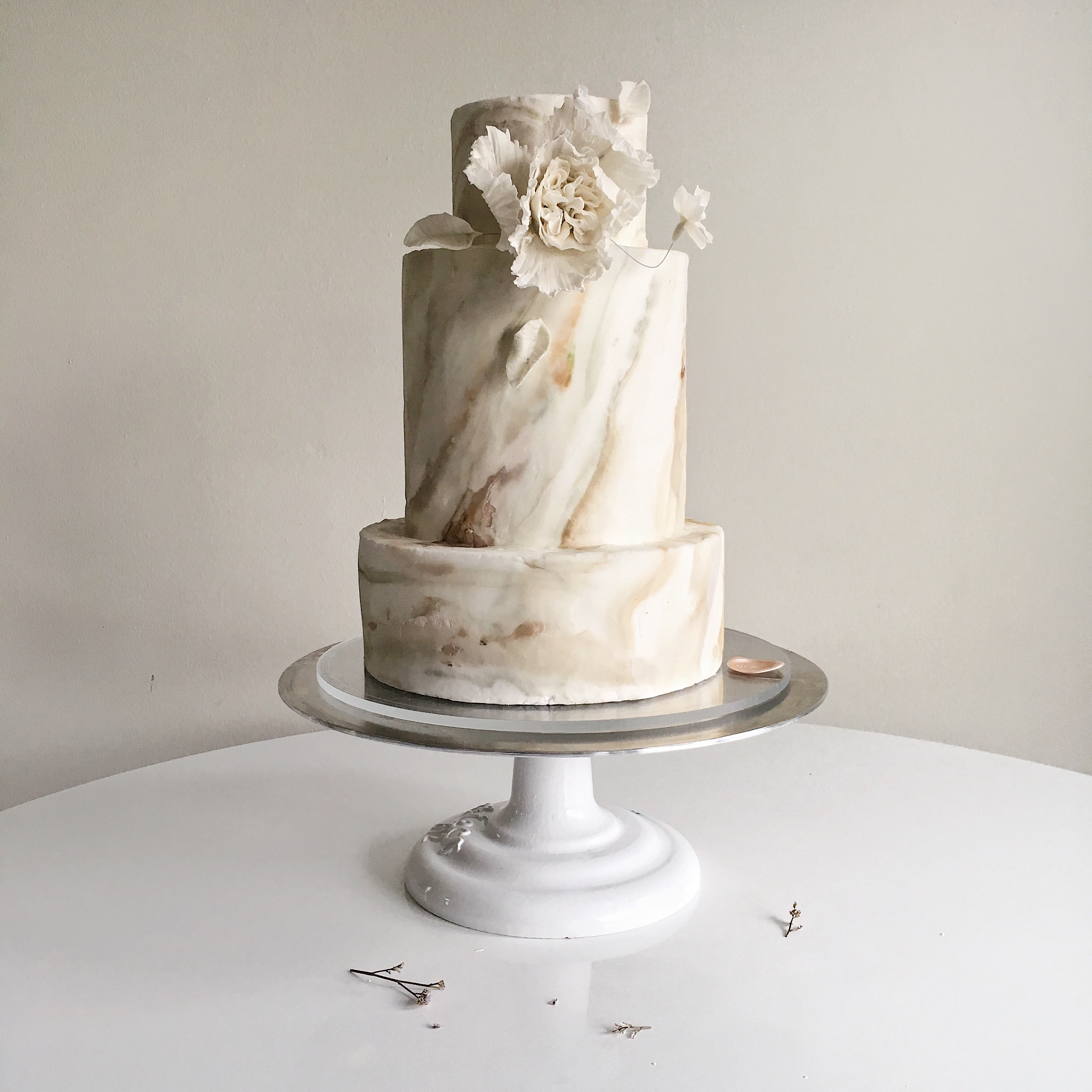 Ivory marbled fondant wedding cake