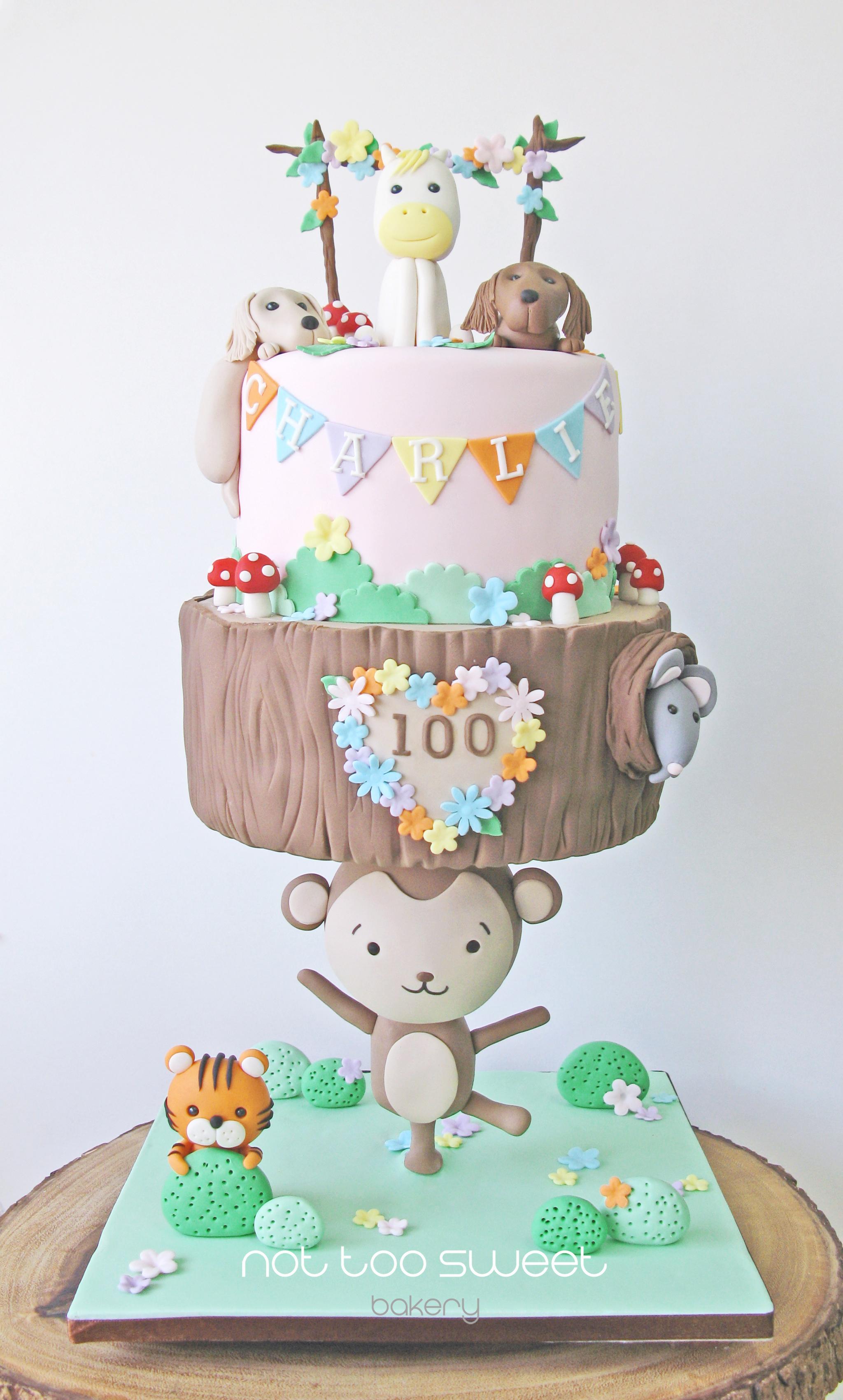 Gravity defying fondant monkey safari baby cake