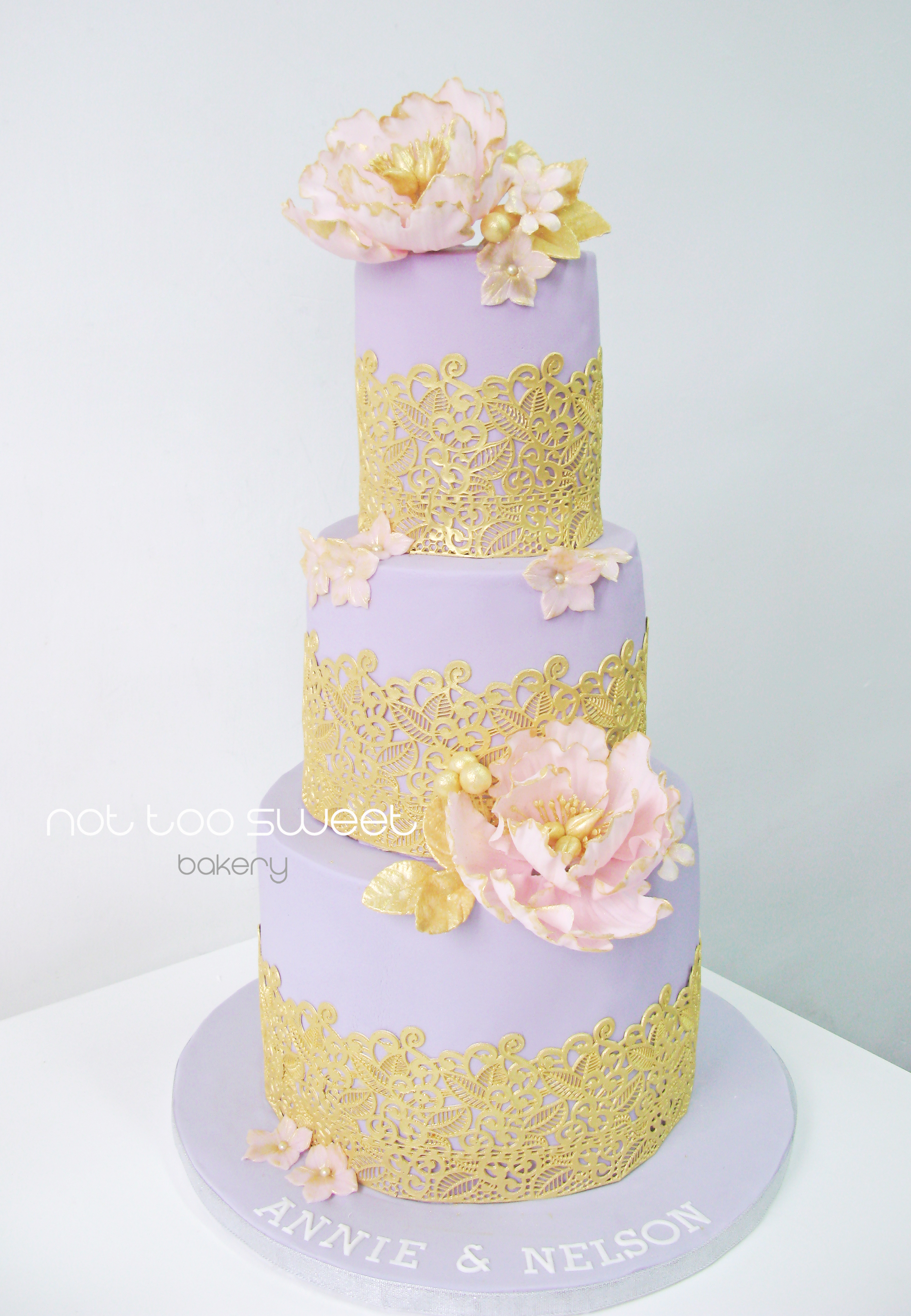 Lavender and gold wedding cake