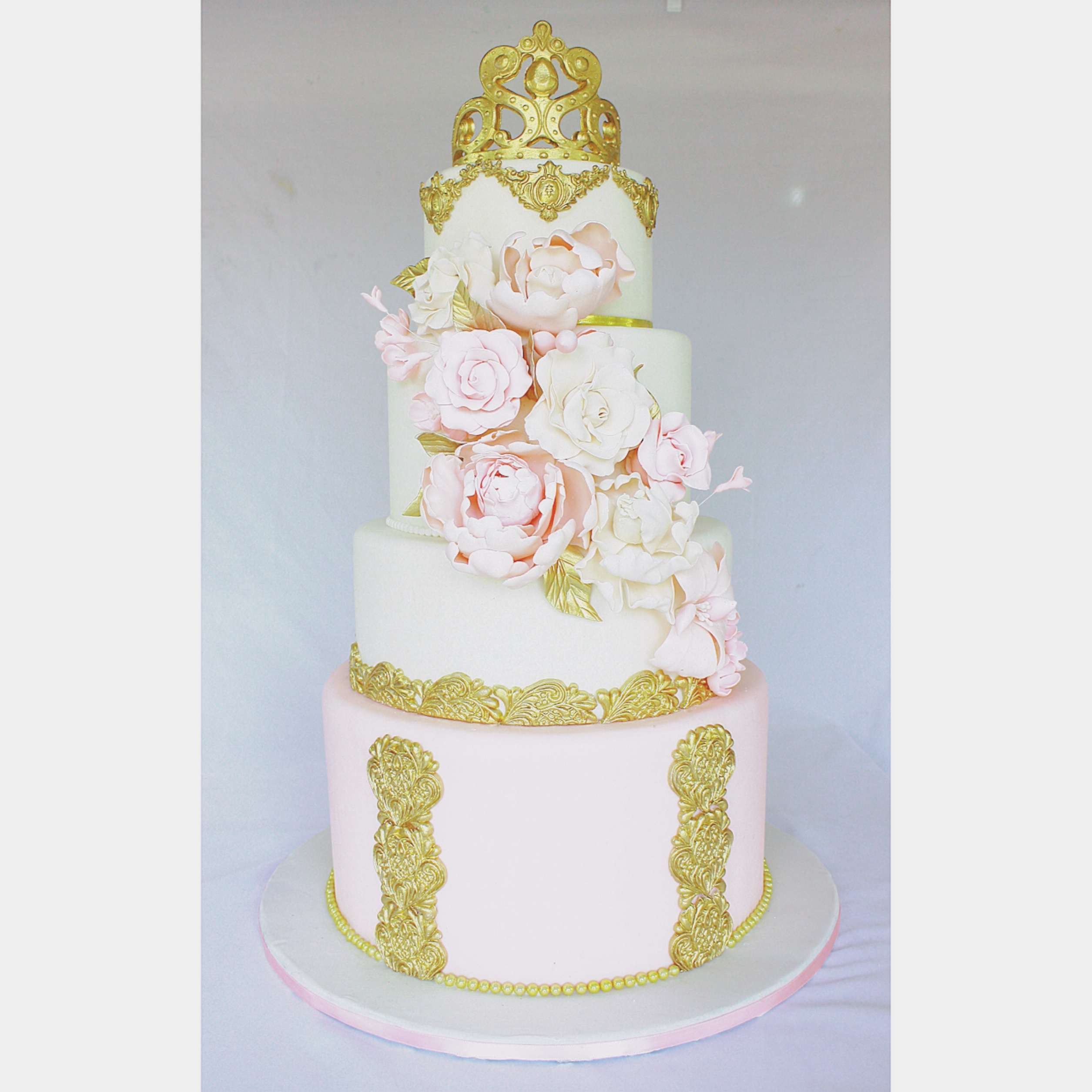 Pink and gold princess birthday cake with sugar flowers