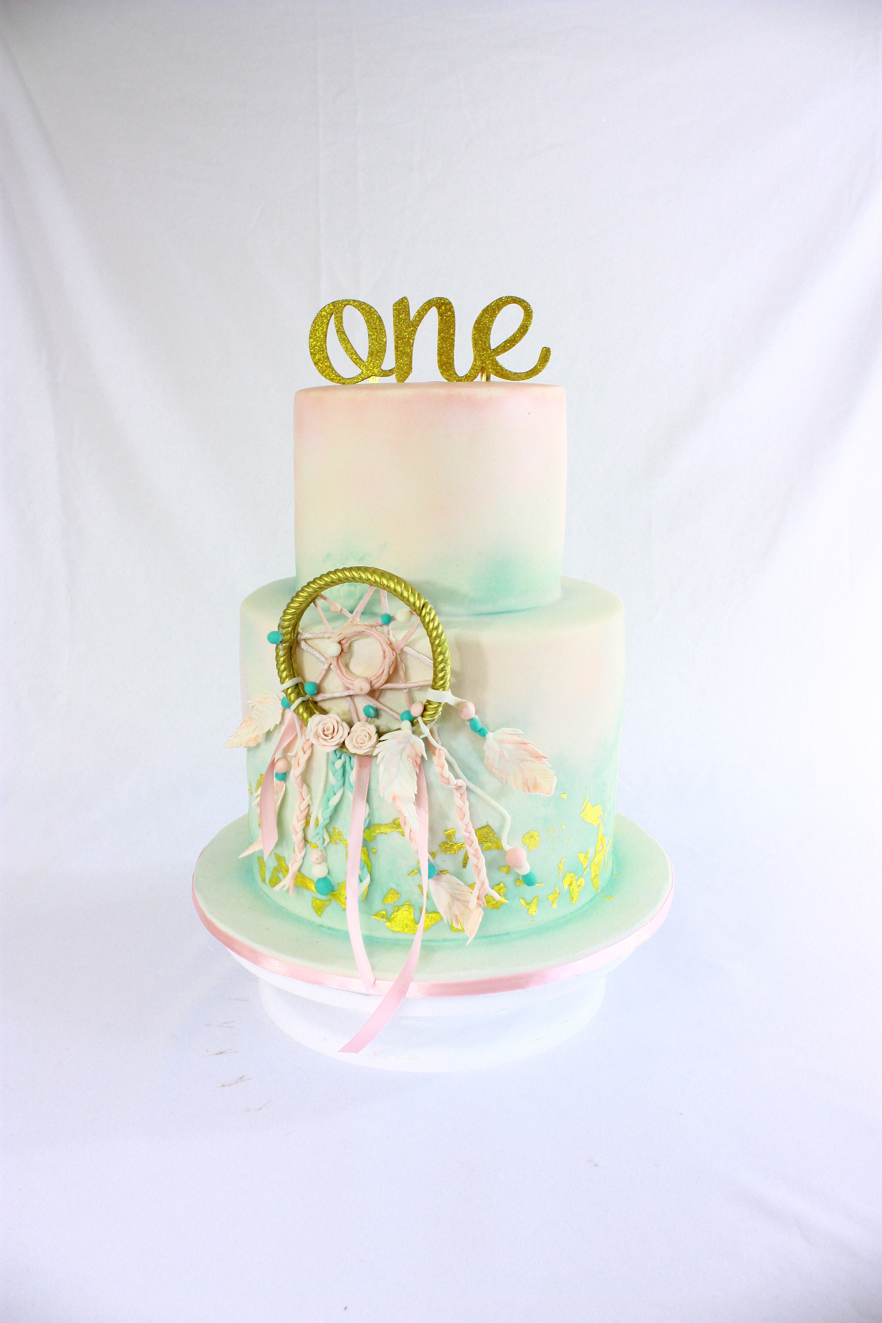 Watercolor boho first birthday cake
