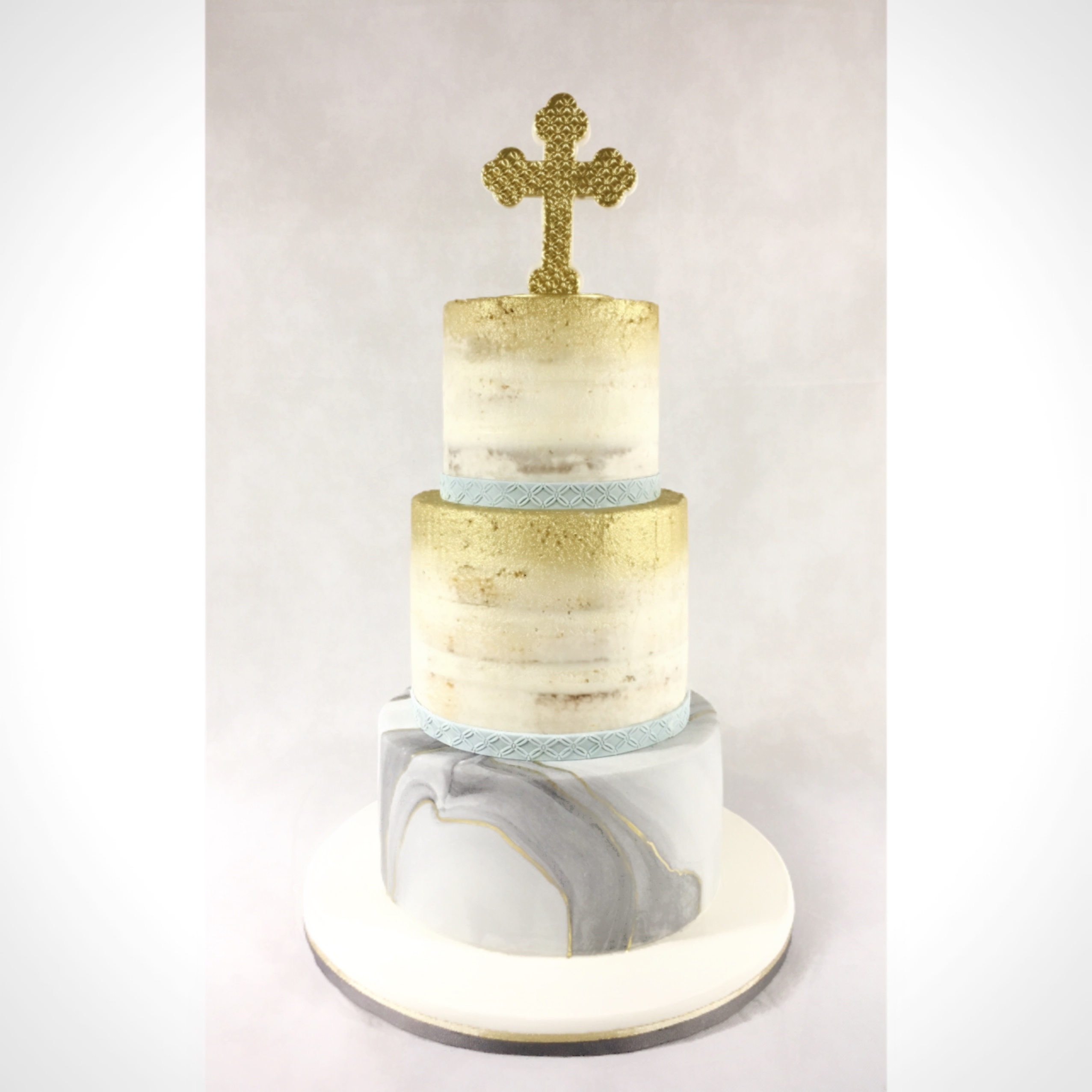 Gray with gold and white baptism cake