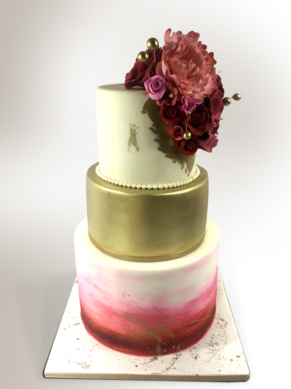 Gold and red ombre wedding cake
