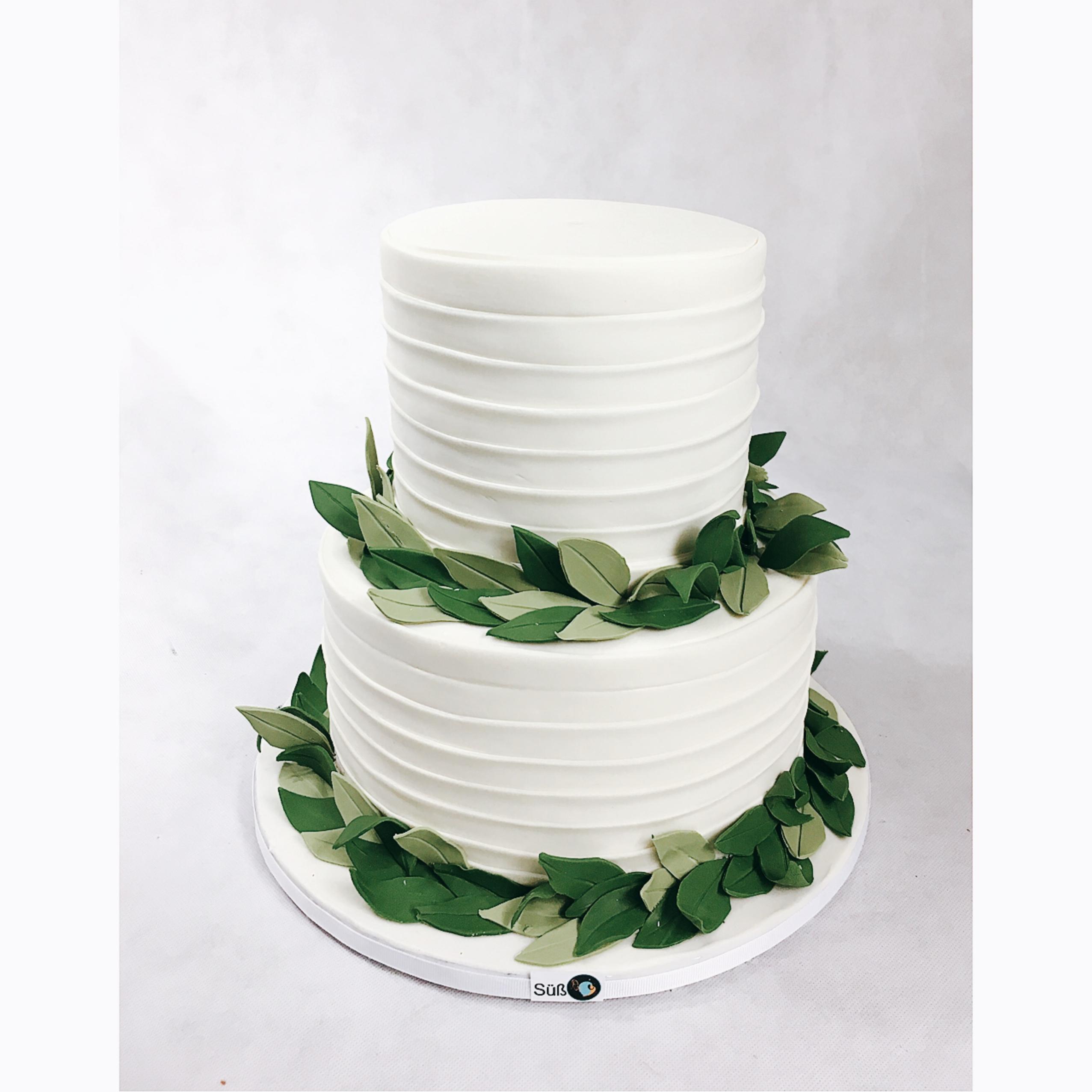 White fondant wedding cake with gum paste fern greenery