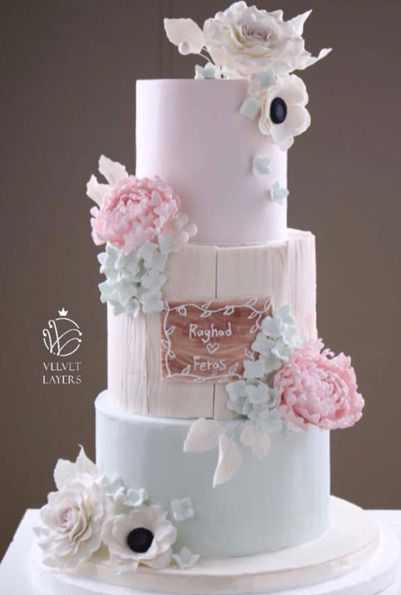 Pastel colored rustic bark wedding cake with sugar flowers