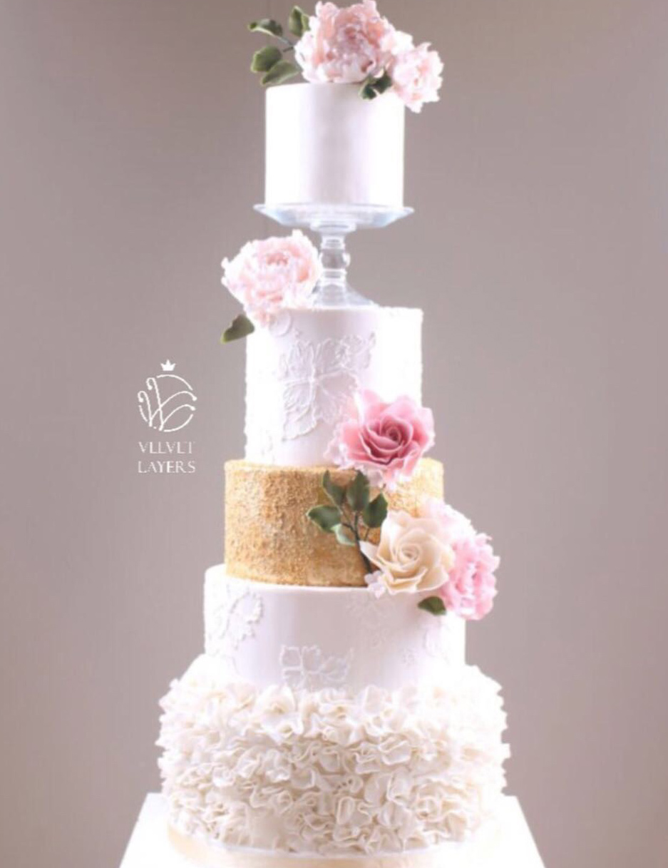 Gold and white ruffle wedding cake