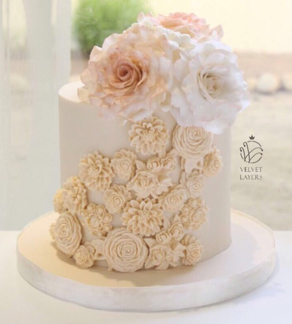 white fondant cake with bas relief texture