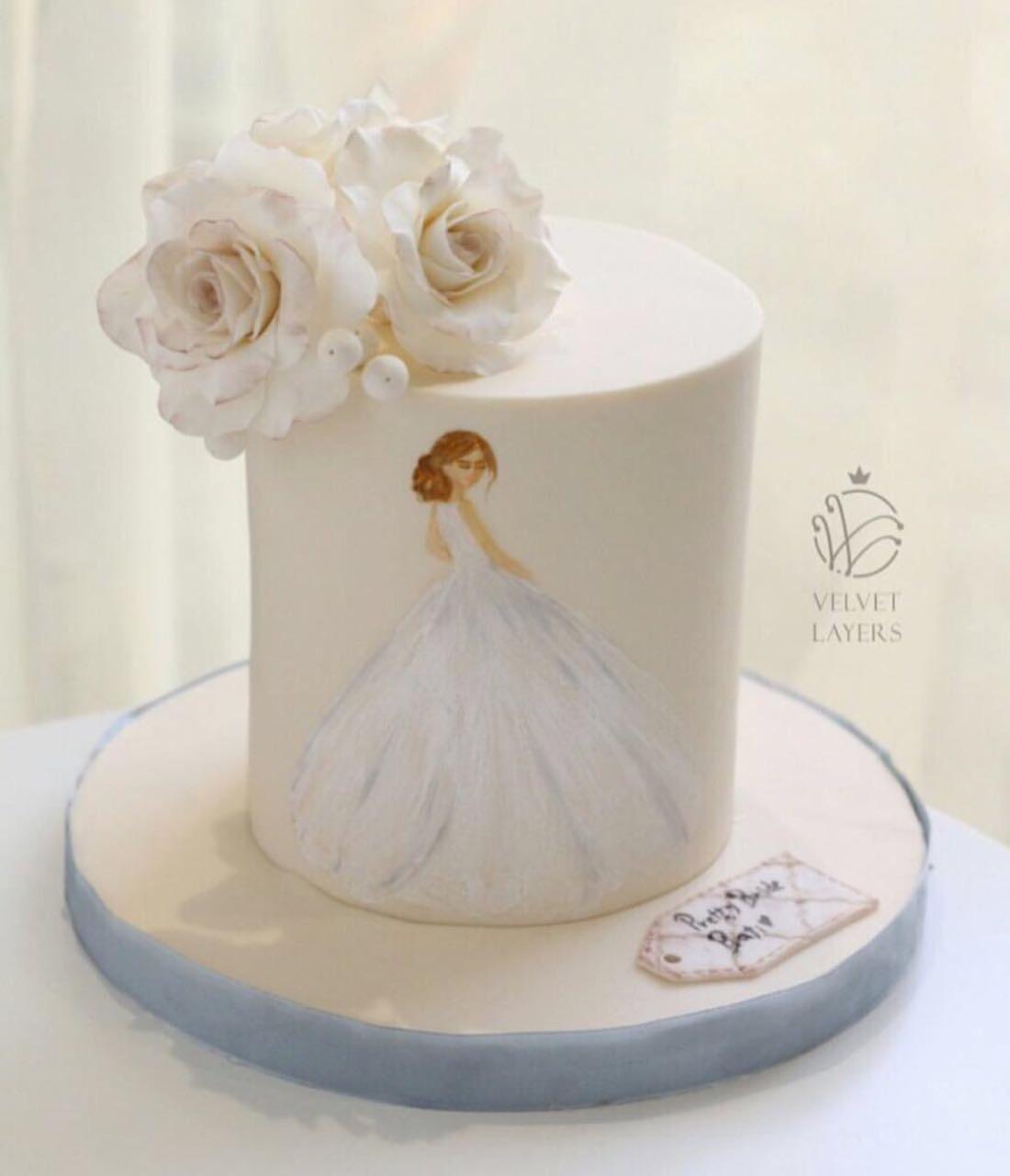Ivory hand painted wedding dress cake