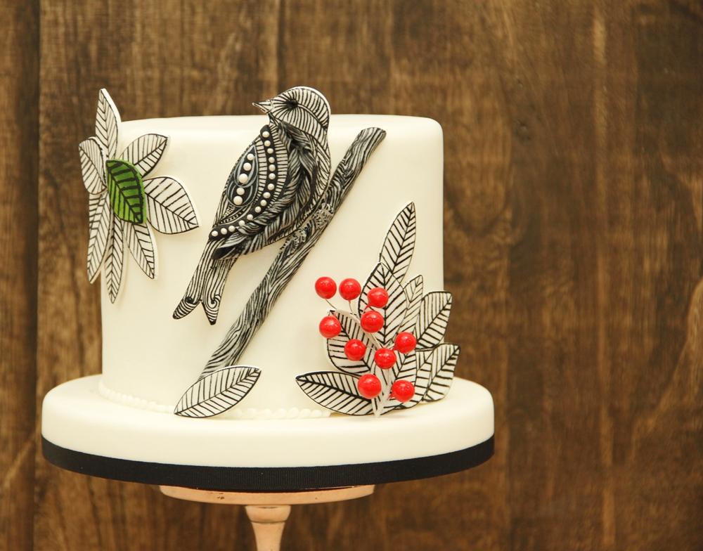 White and black mini bird cake