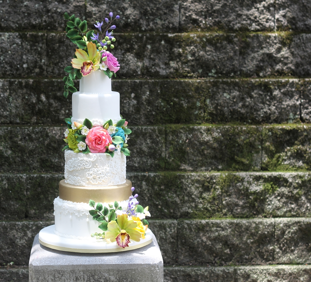 White lace wedding cake with sugar flowers
