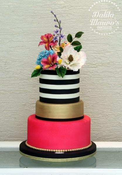 Black and white striped wedding cake with pink