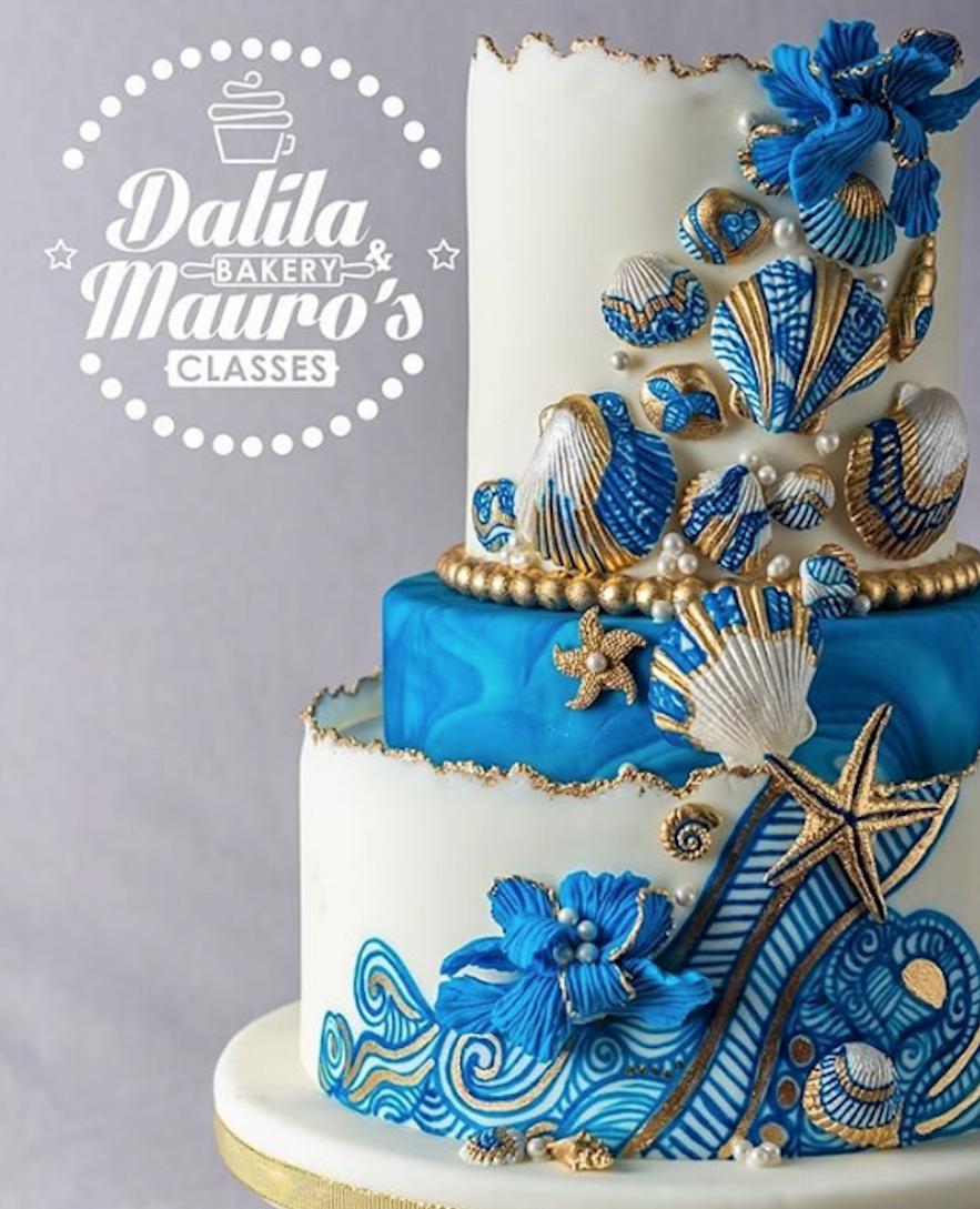 White fondant wedding cake with blue waves