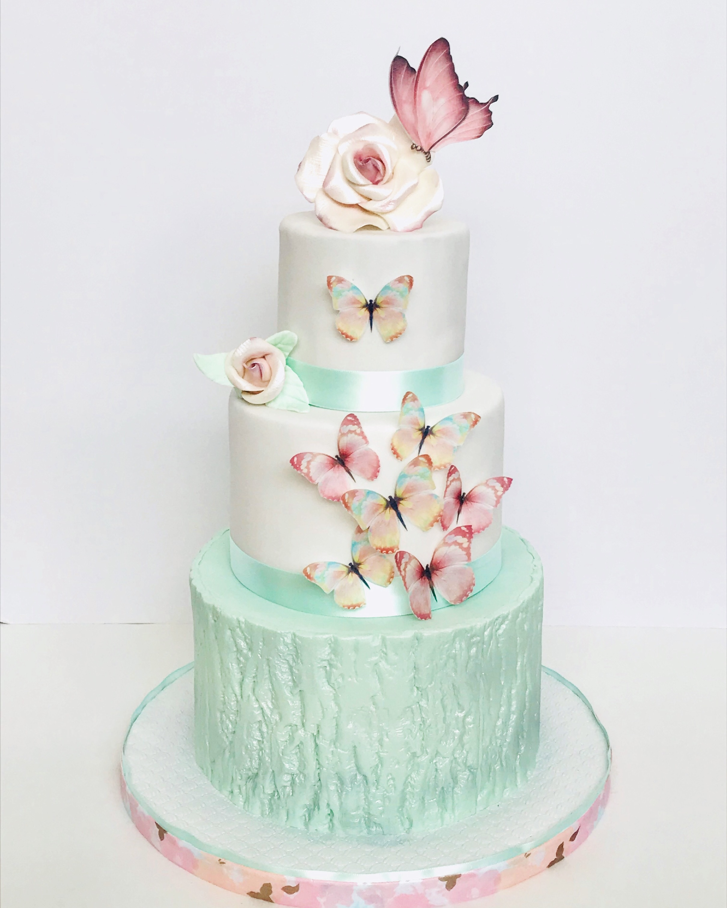 Light green and white butterfly fondant wedding cake