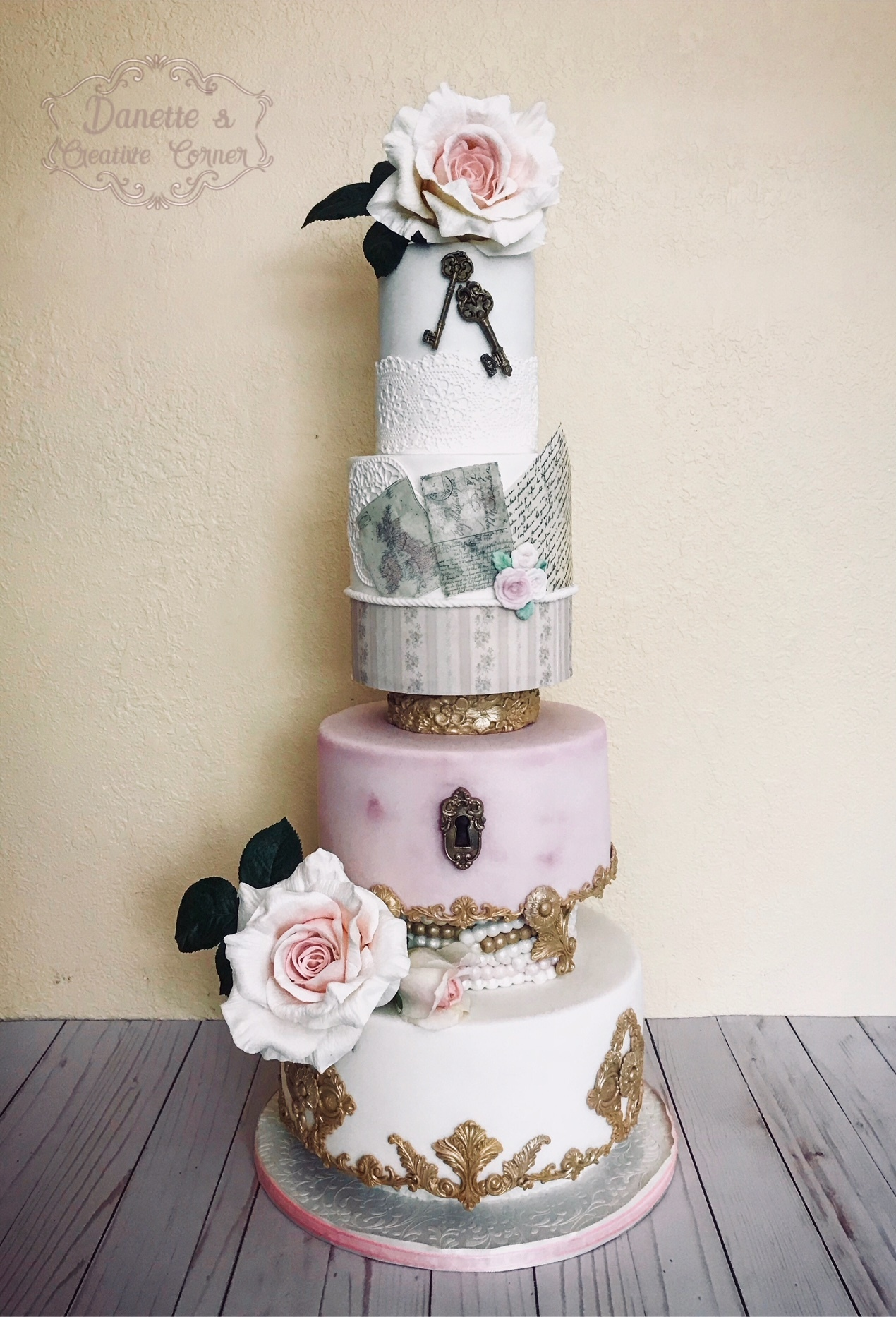 Light pink and white enchanted garden fondant wedding cake