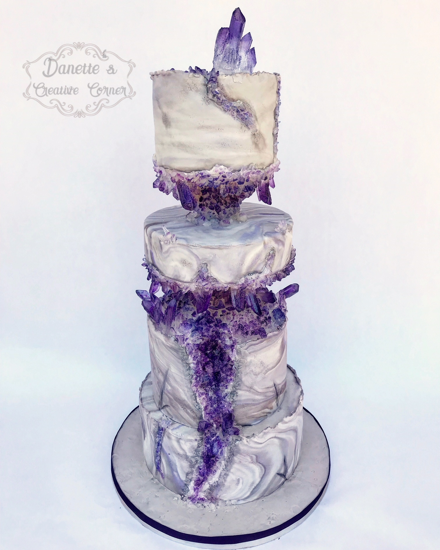 Purple fondant wedding cake with crystals