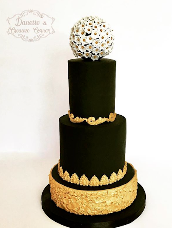 Black and gold fondant wedding cake