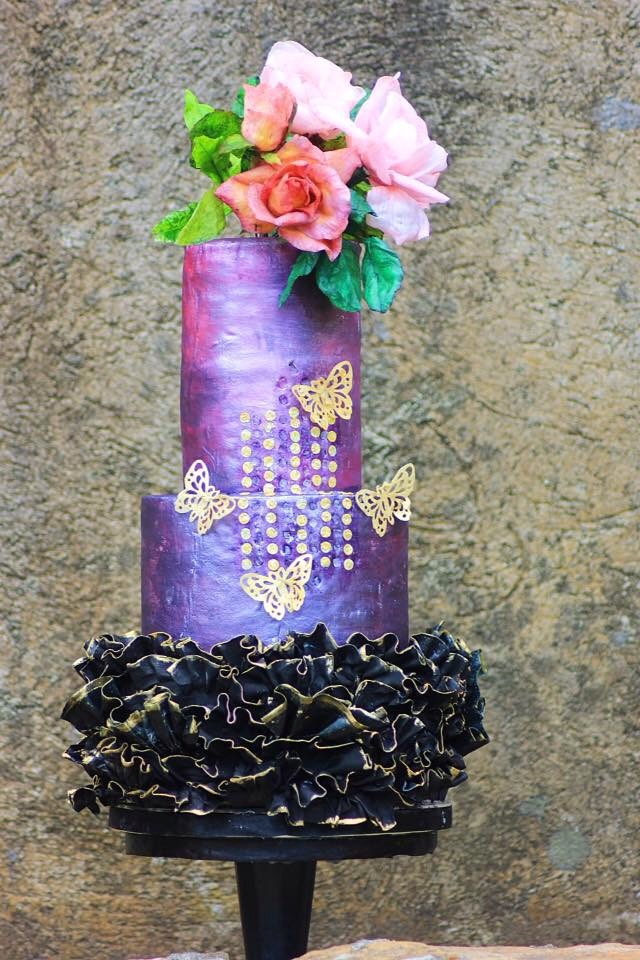 Shades of purple wedding cake with black ruffles