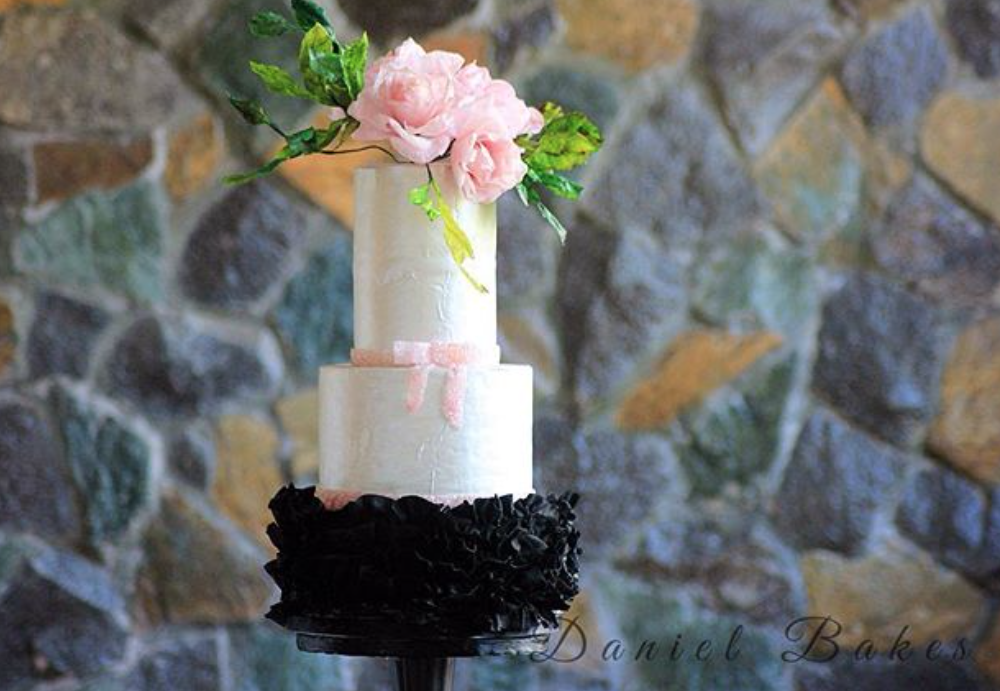 Black and white wedding cake with rufflesd