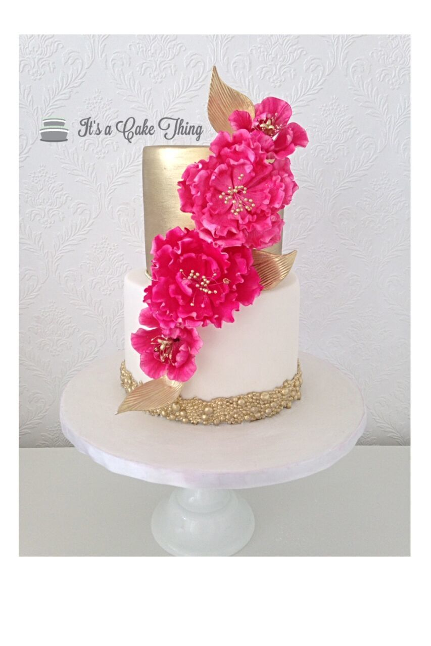 Gold Shimmer Wedding with fuchsia sugar flowers
