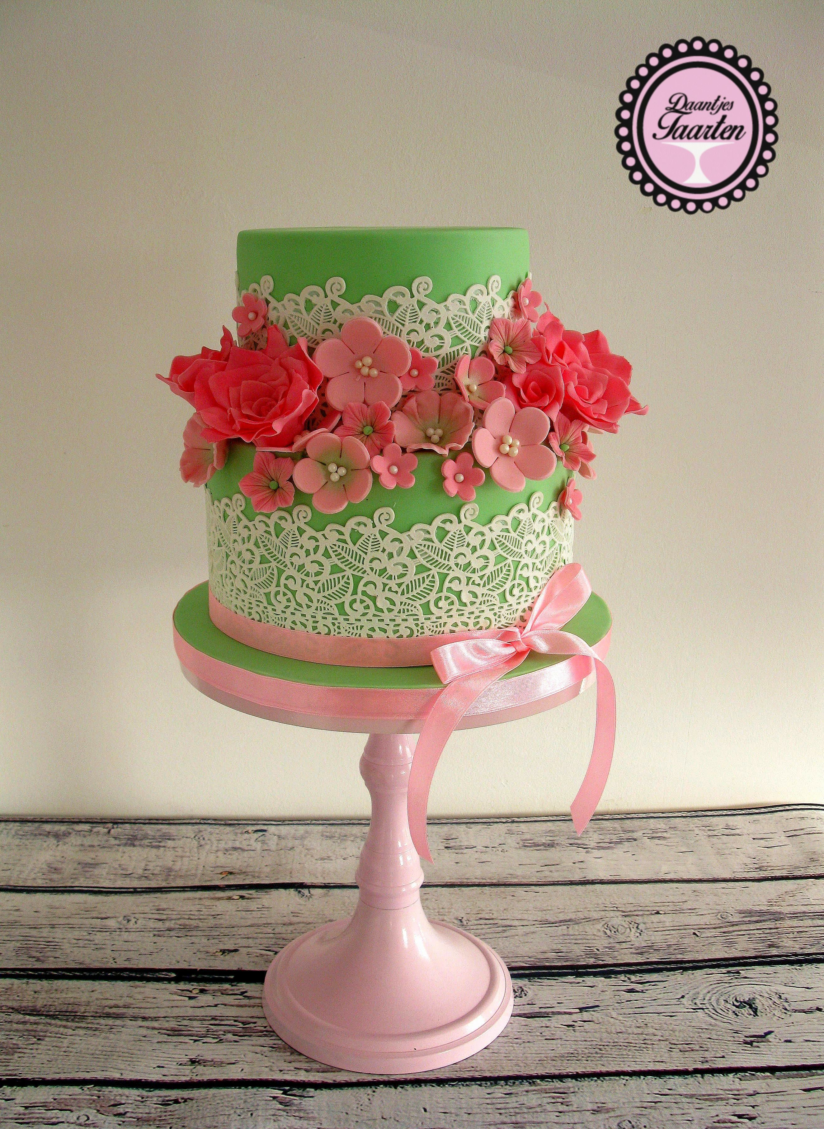 Green fondant Cake with coral sugar flowers