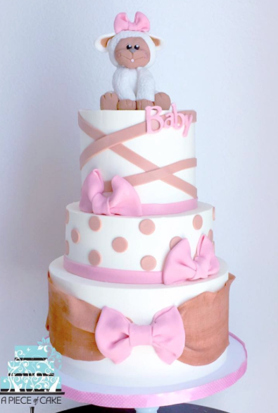 Pink and white Doc McStuffins baby cake