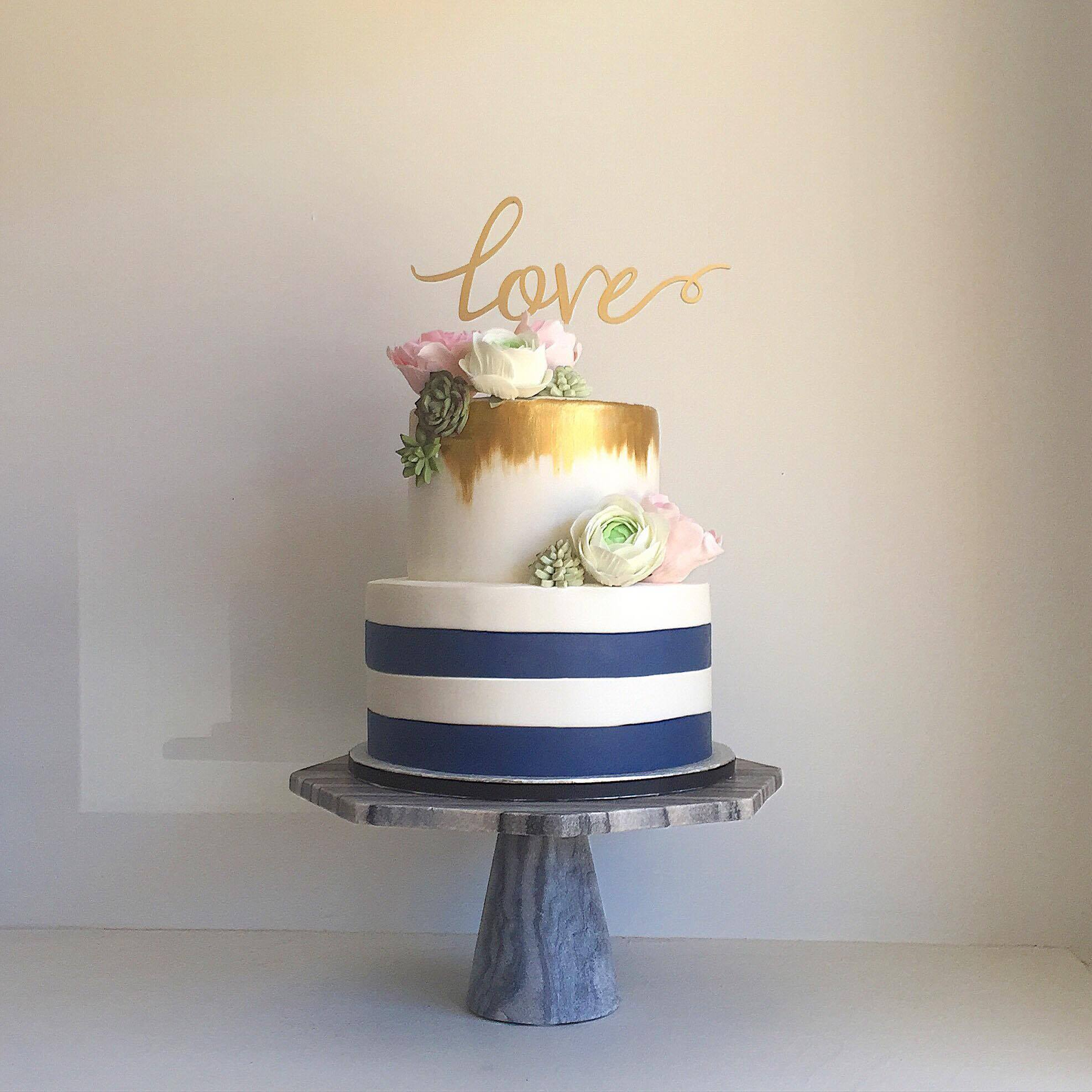 Blue & White striped fondant wedding cake with gold