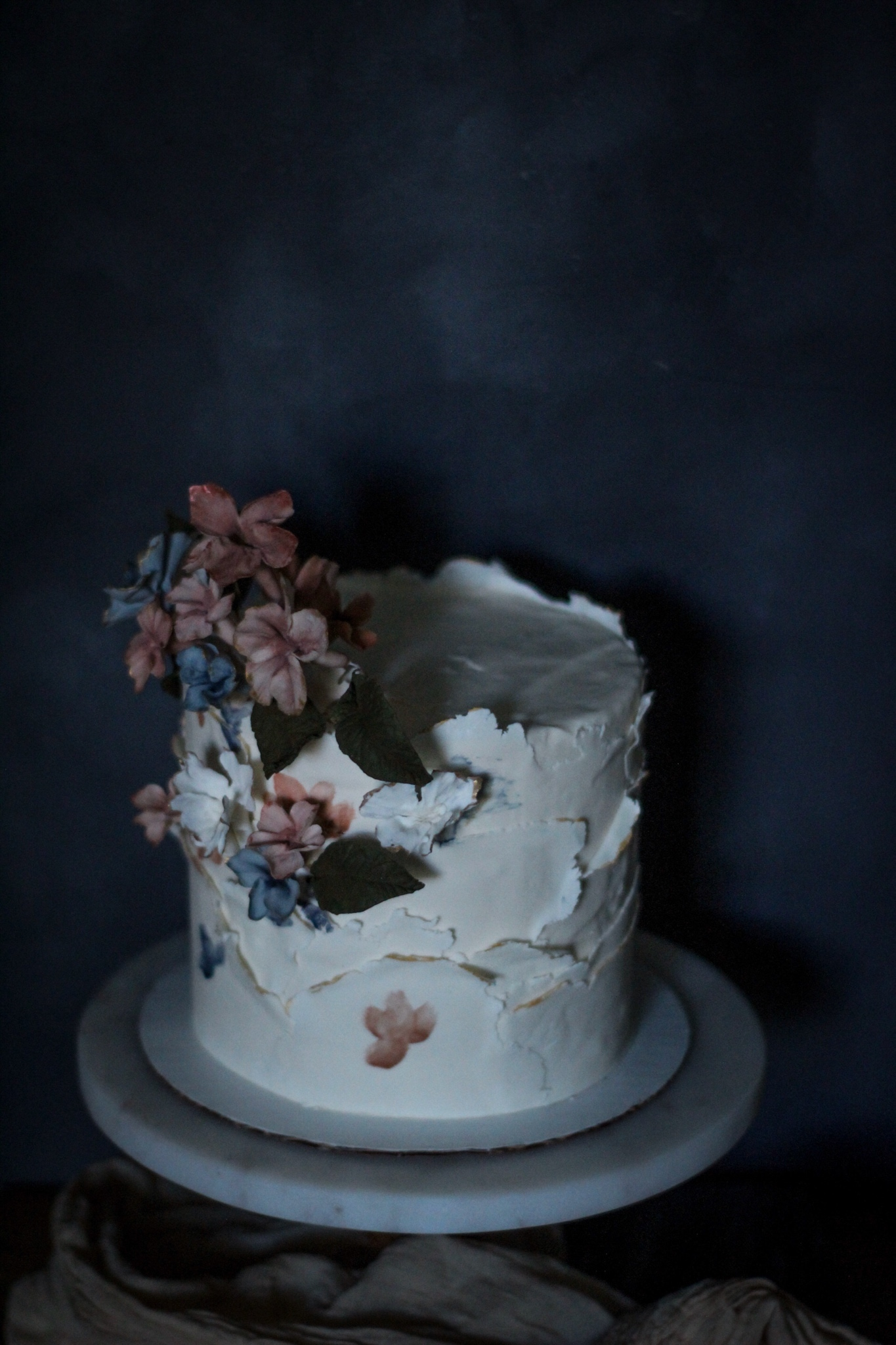 White Bas relief fondant cake with sugar flowers