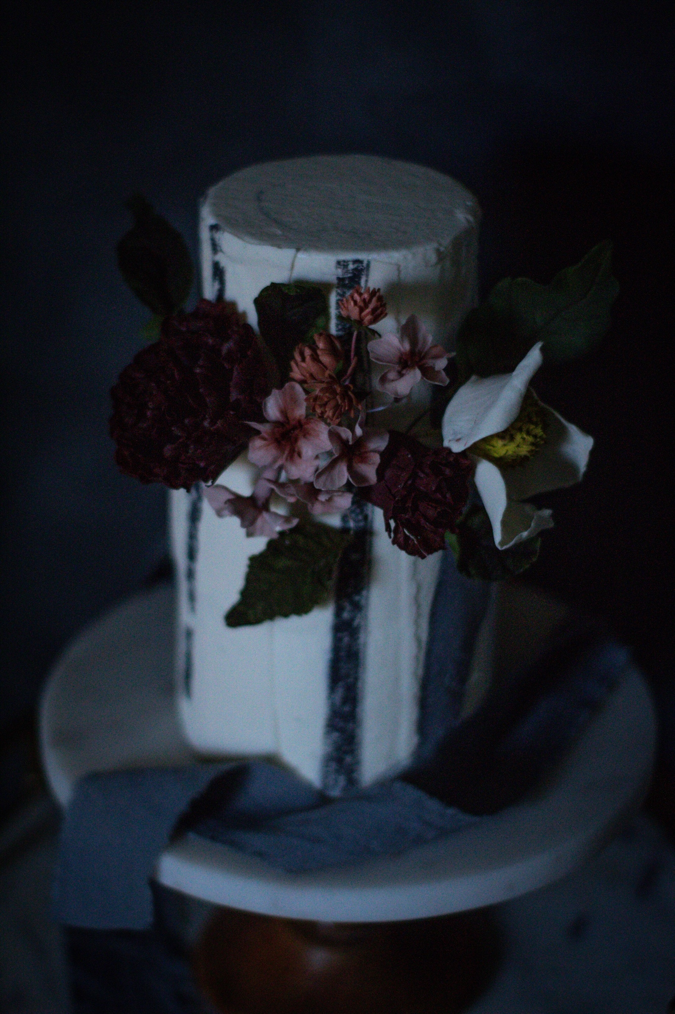 White cake with rich colored sugar flowers