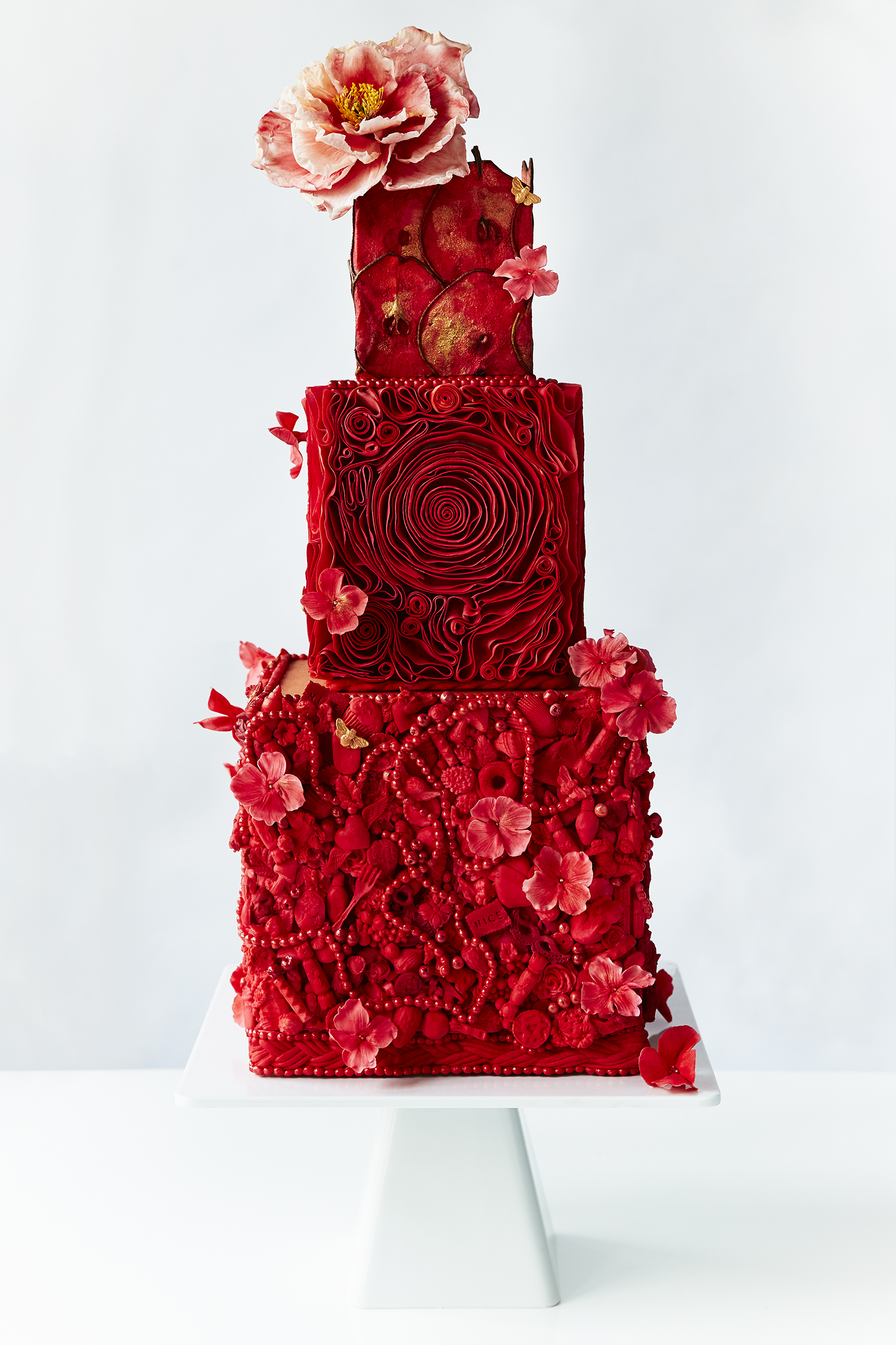 All red wedding cake fondant wedding cake with rosettes and ruffles