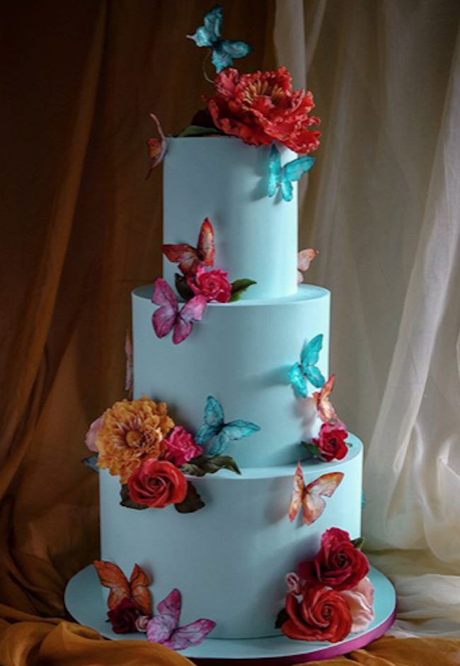 All blue wedding cake with butterflies