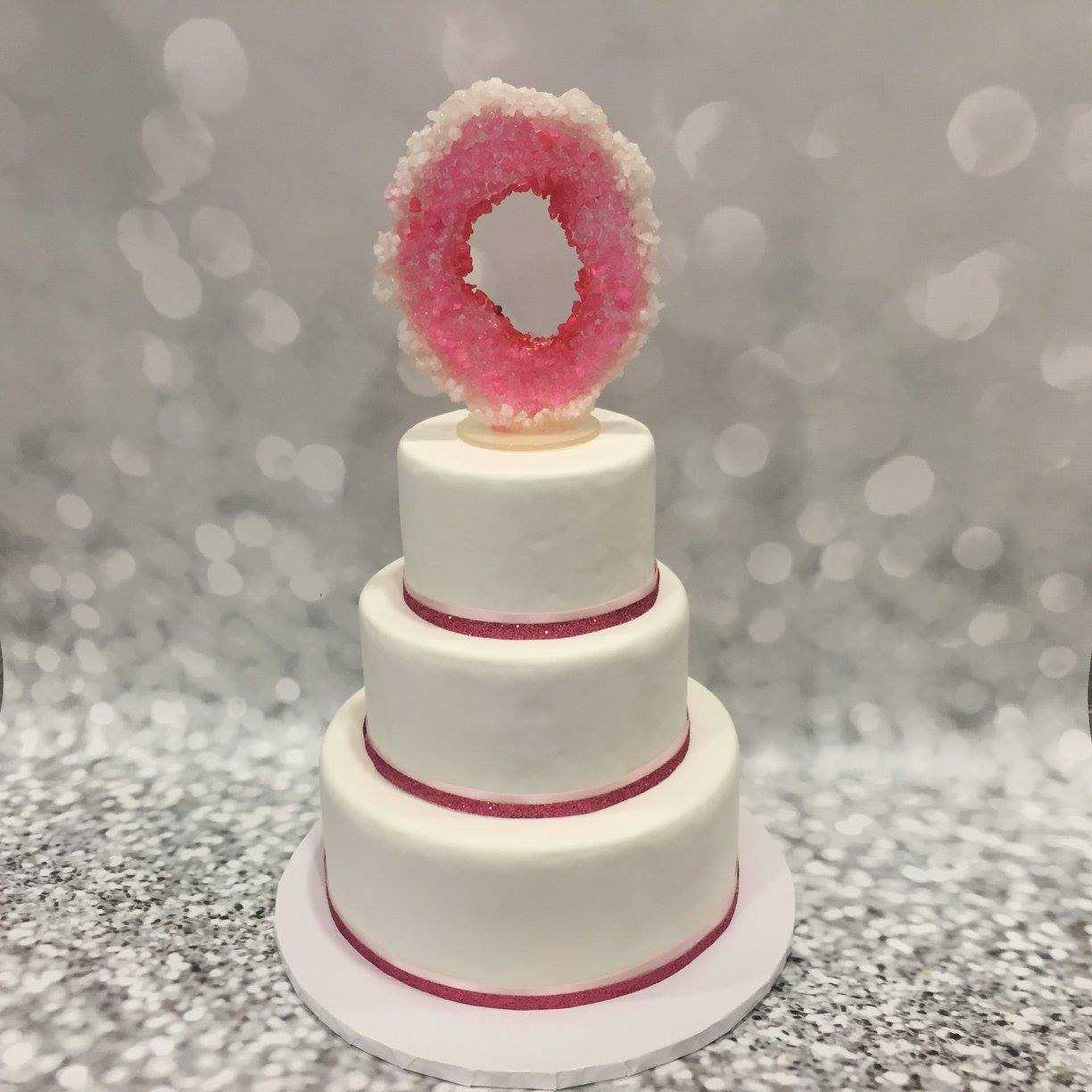 White fondant wedding cake Pink crystal topper