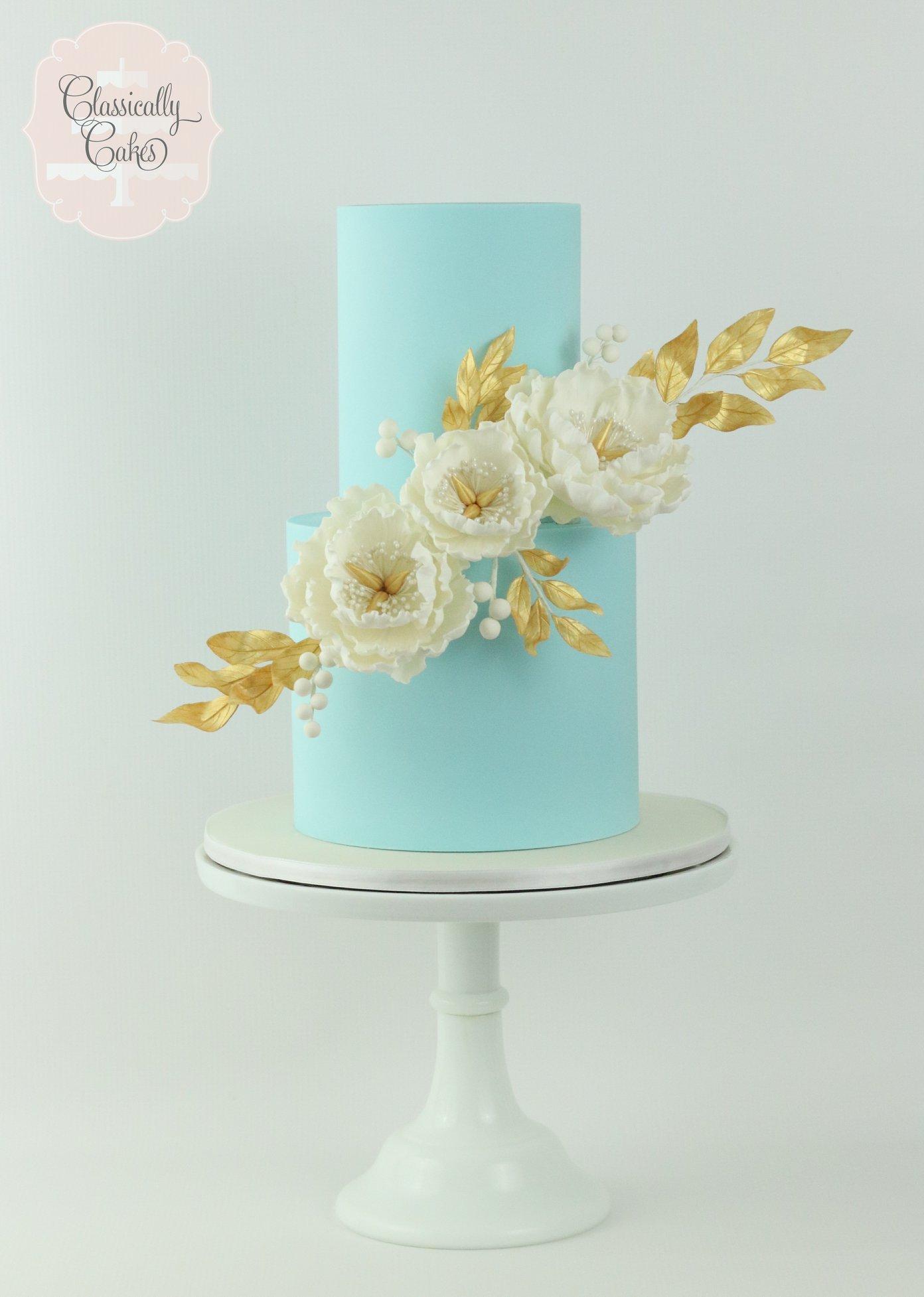 Baby blue fondant wedding cake with ivory sugar roses