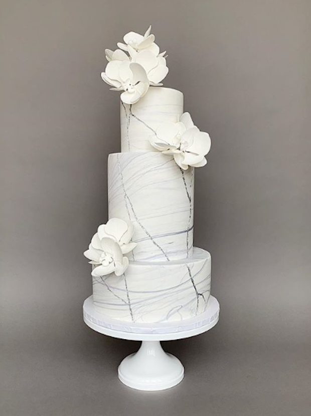 White cement textured fondant wedding cake