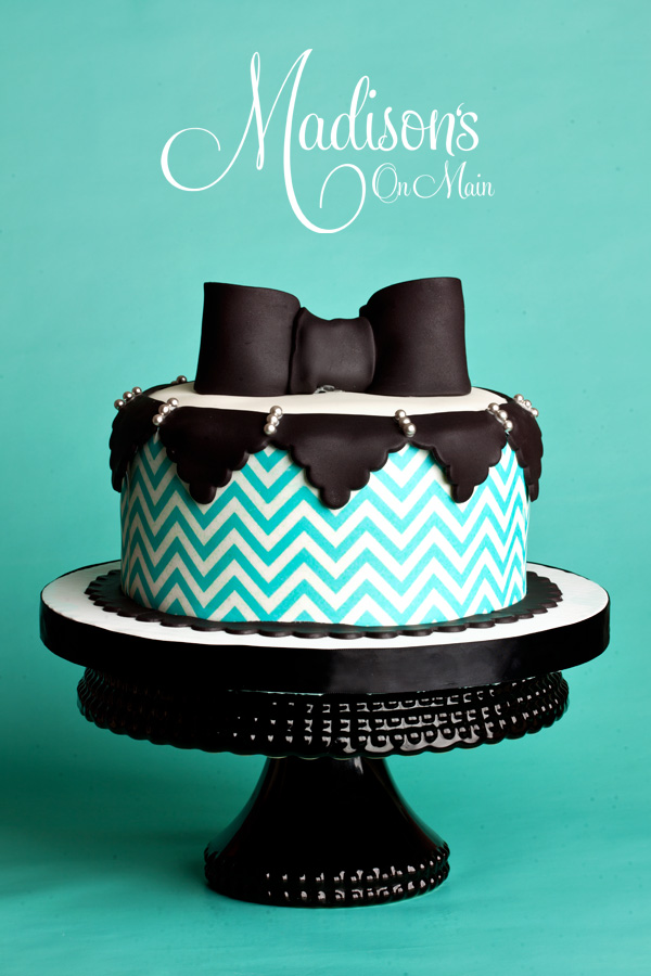 Turquoise and black bow tie cake